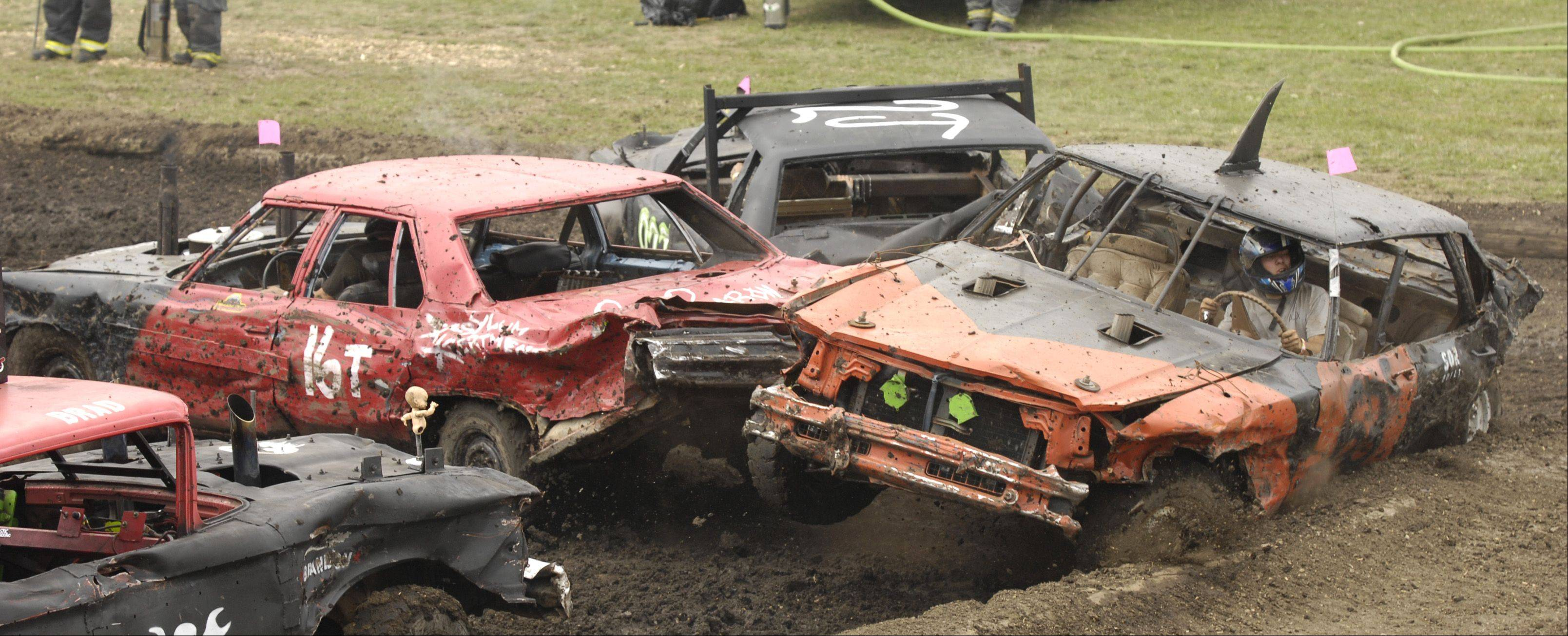 Rob Moore of Villa Park in 16T smashes into one of his competitors during the demolition derby Sunday at the DuPage County Fair.