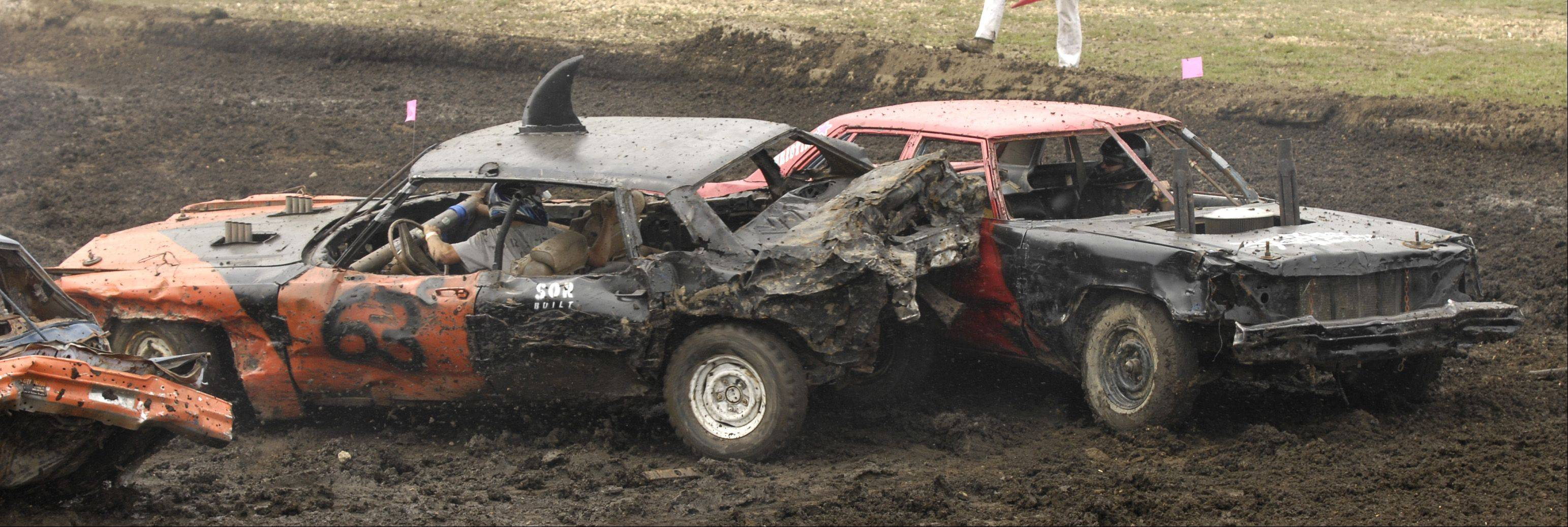Competitors hit each other hard during the annual demolition derby Sunday at the DuPage County Fair.