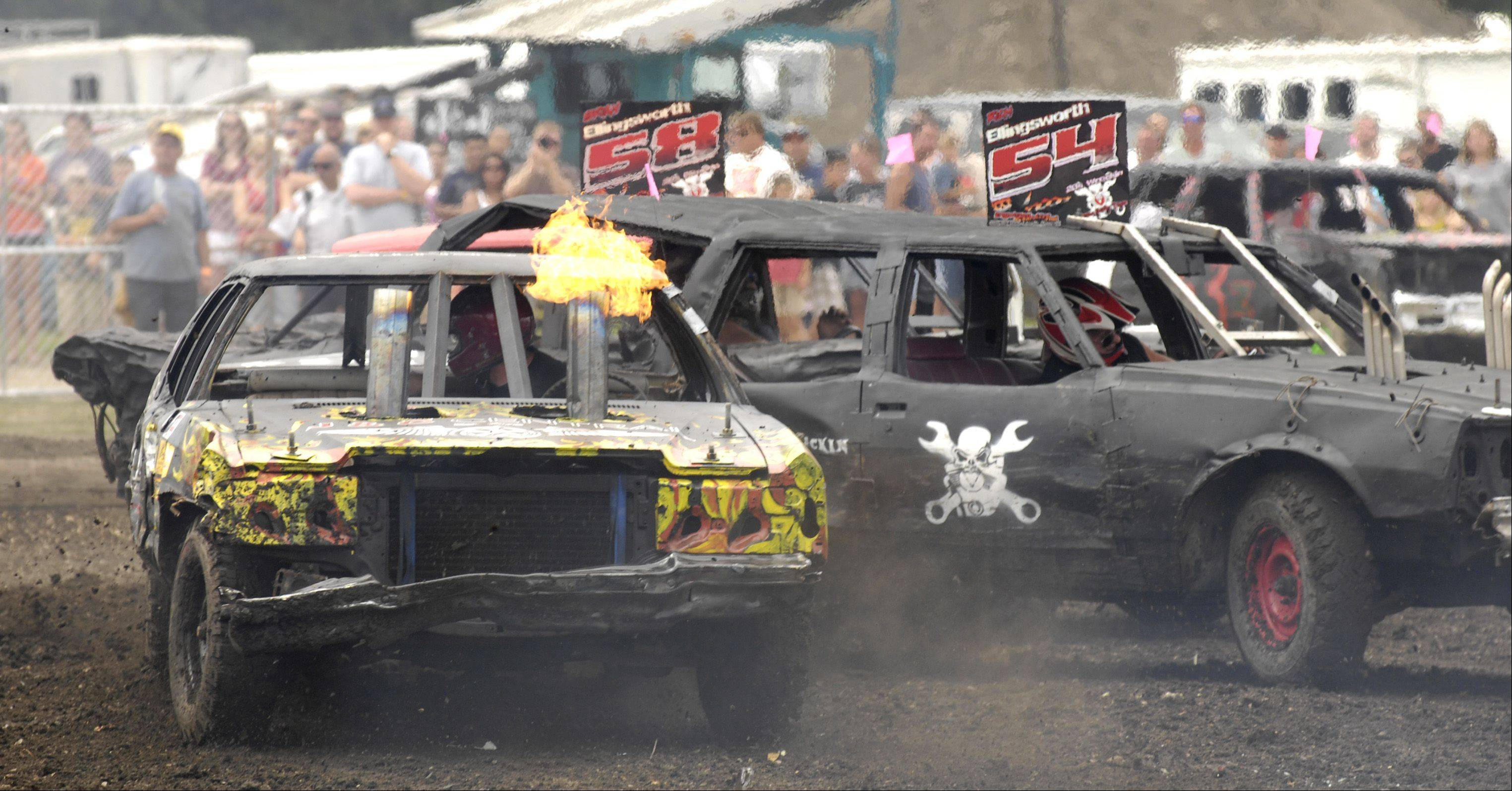 Flames shoot from the exhaust of a car during the annual demolition derby Sunday at the DuPage County Fair.