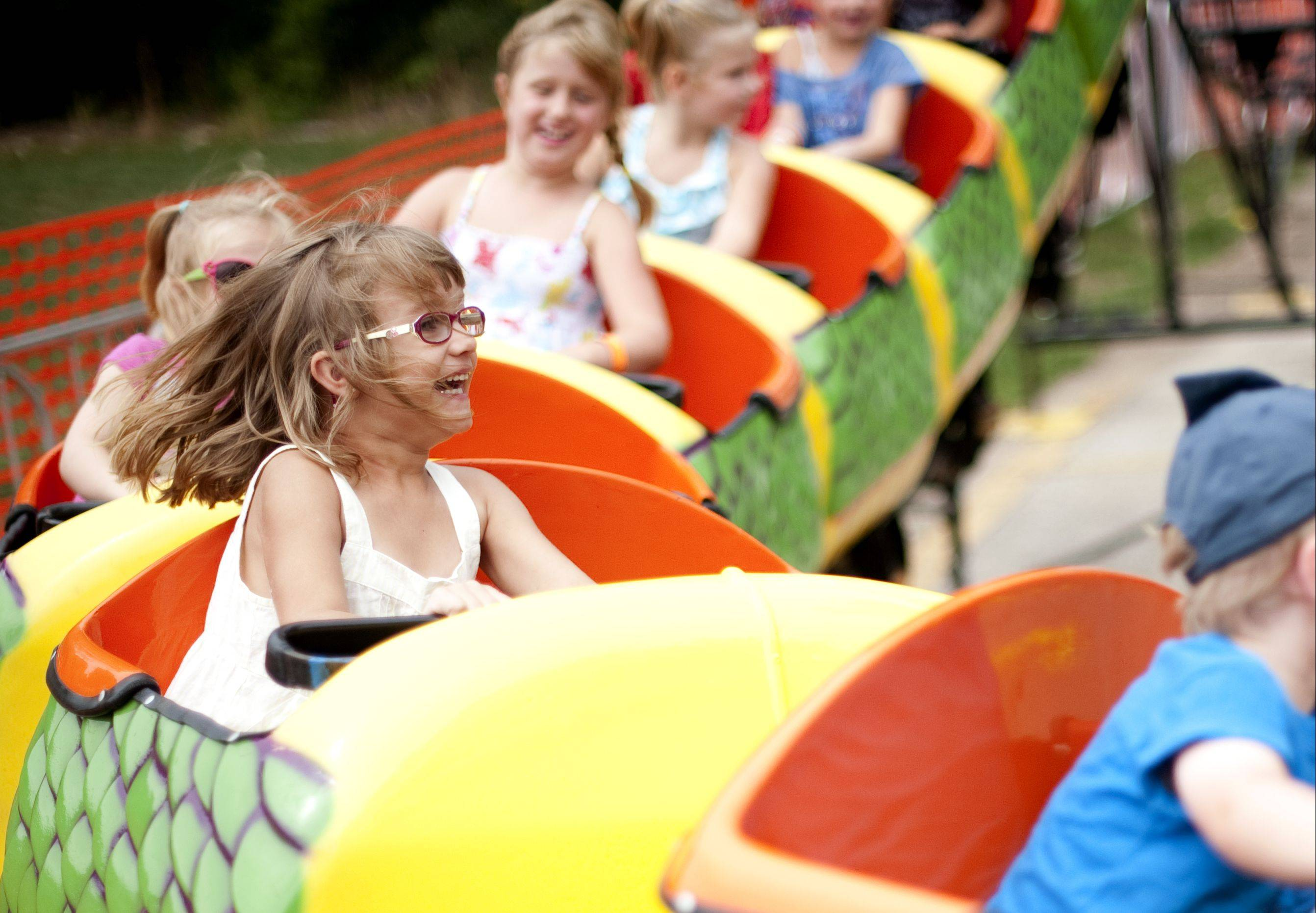 Kids round a bend in the child-size roller coaster Sunday at the 52nd Algonquin Founders Days in Algonquin's Towne Park.