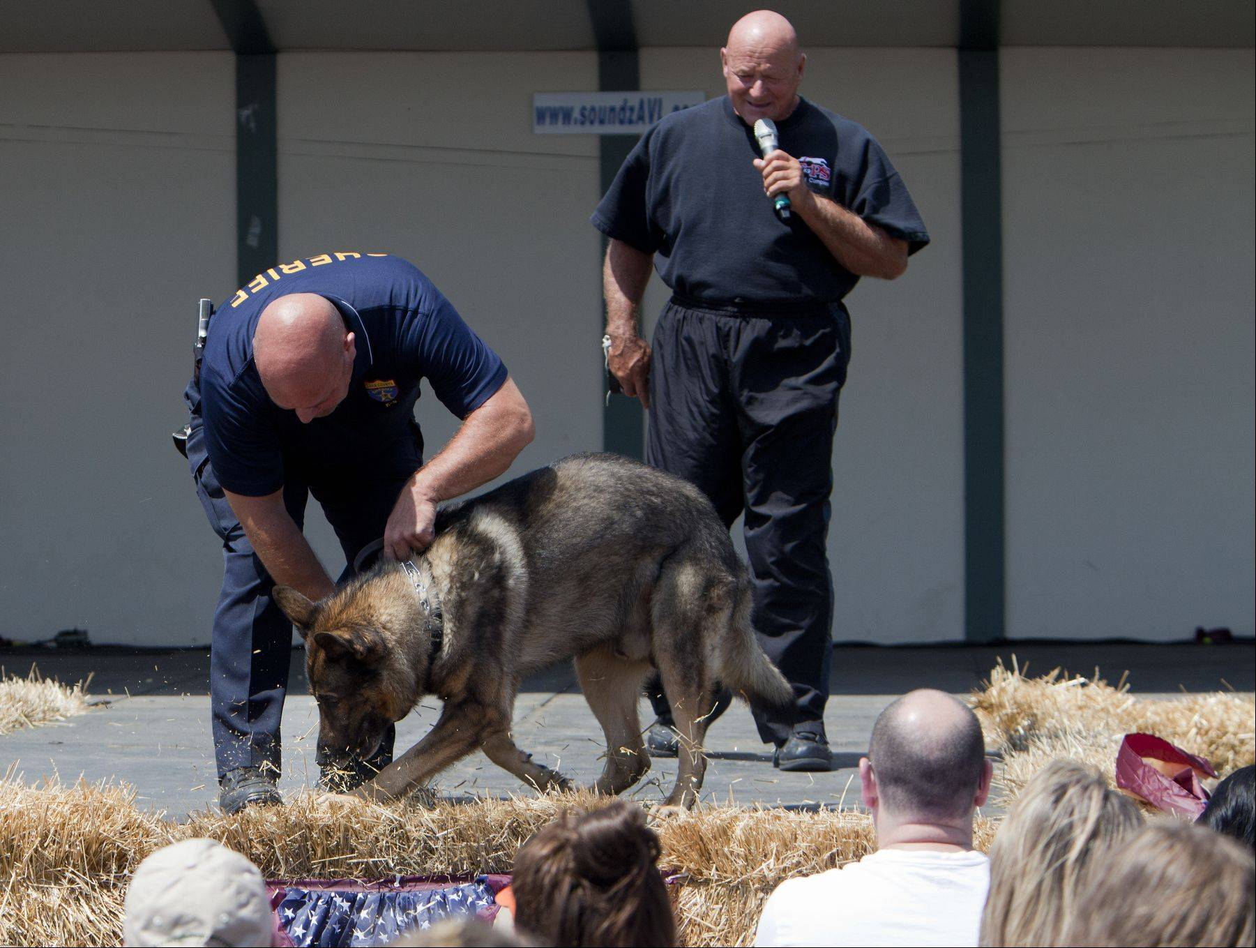 Lake County Sherif K-9 Officer Tony Fanella shows the audience how Thor digs to find and help point out where narcotics may be hidden, also pictured Tops in Training in Grayslake owner Alex Rothacker.
