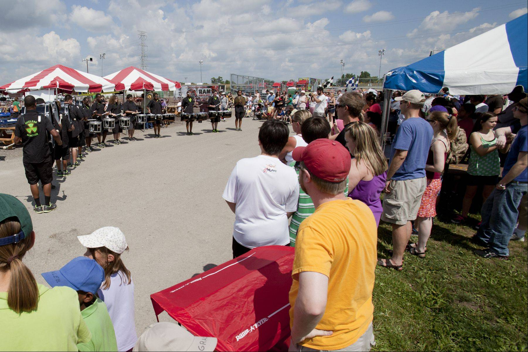 Nuclear Reaction drum line pumps up the crowd at the Lake County Fair on Saturday.