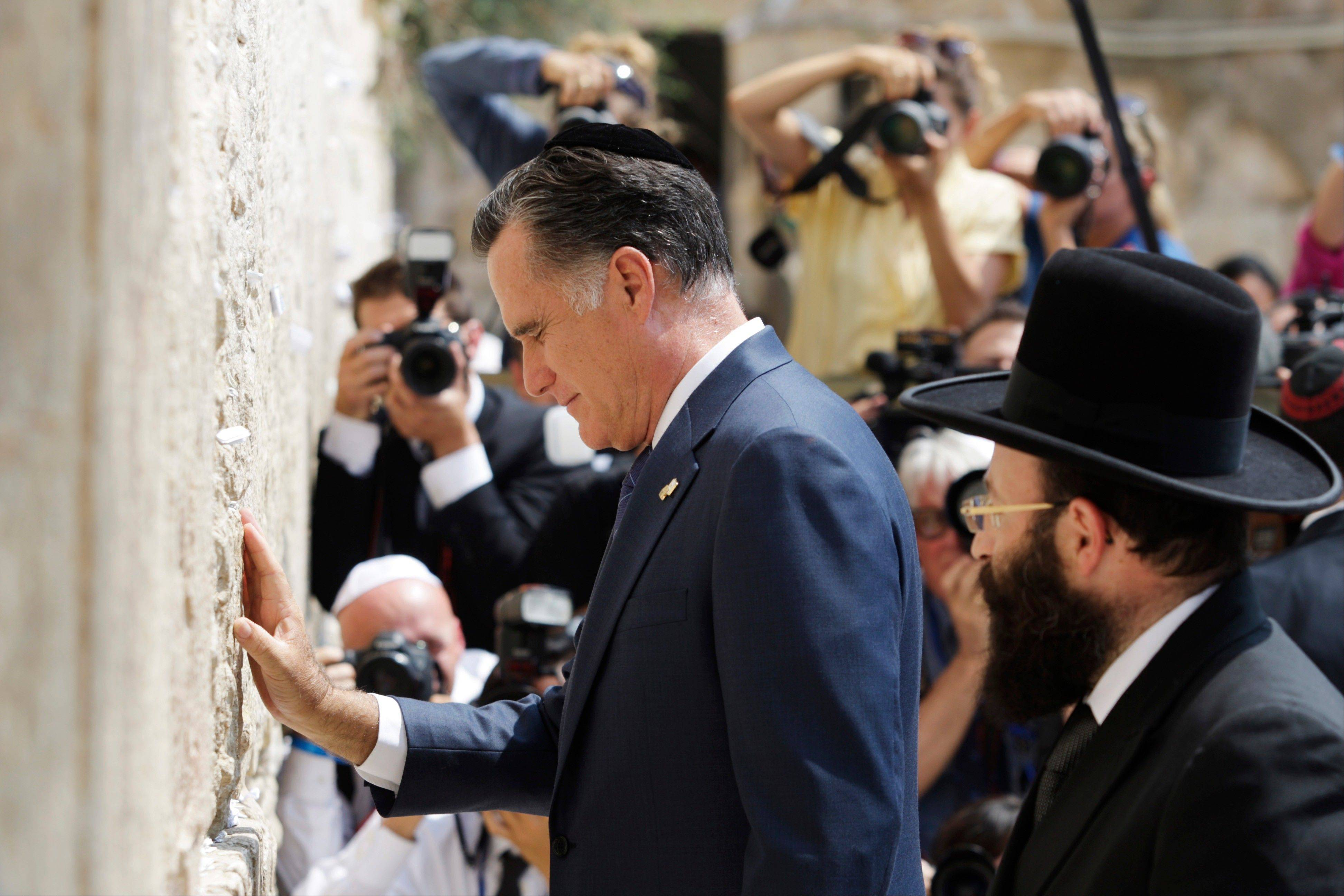 Republican presidential candidate and former Massachusetts Gov. Mitt Romney pauses next to the Western Wall, in Jerusalem, Sunday, July 29, 2012.