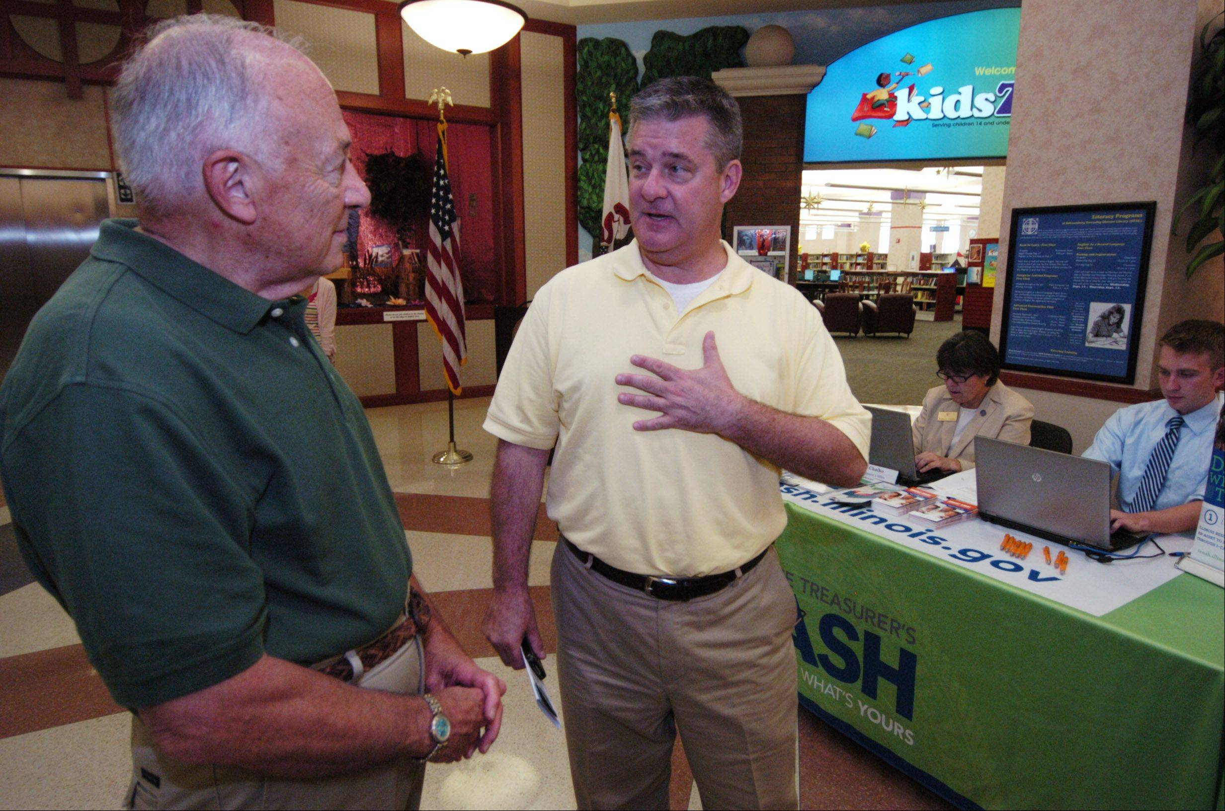 State Treasurer Dan Rutherford, right, speaks with Schaumburg Township District Library board President Robert Frankel during a visit to promote the I-Cash program.