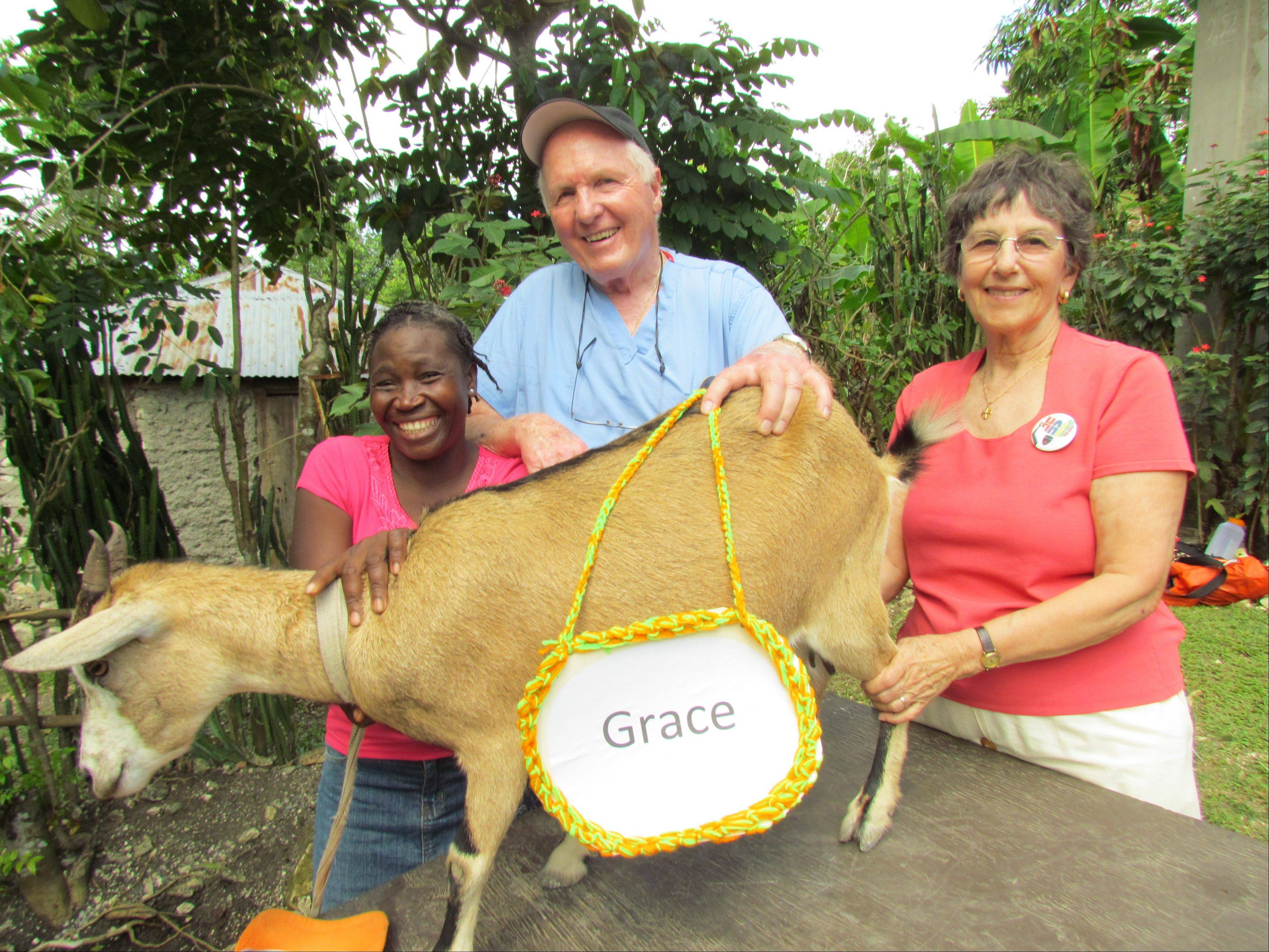 Dr. Jeremiah Lowney, center, started the Give a Goat program 11 years ago. Roughly 600 goats are distributed to rural families a year.