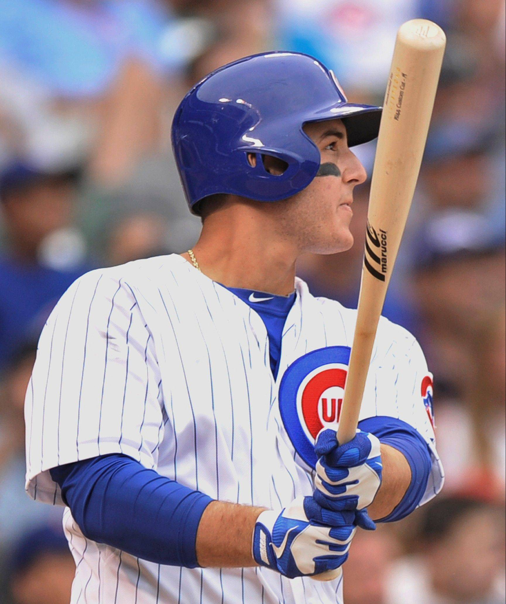 The Cubs' Anthony Rizzo admires his 2-run walkoff home run in the 10th inning Sunday at Wrigley Field.
