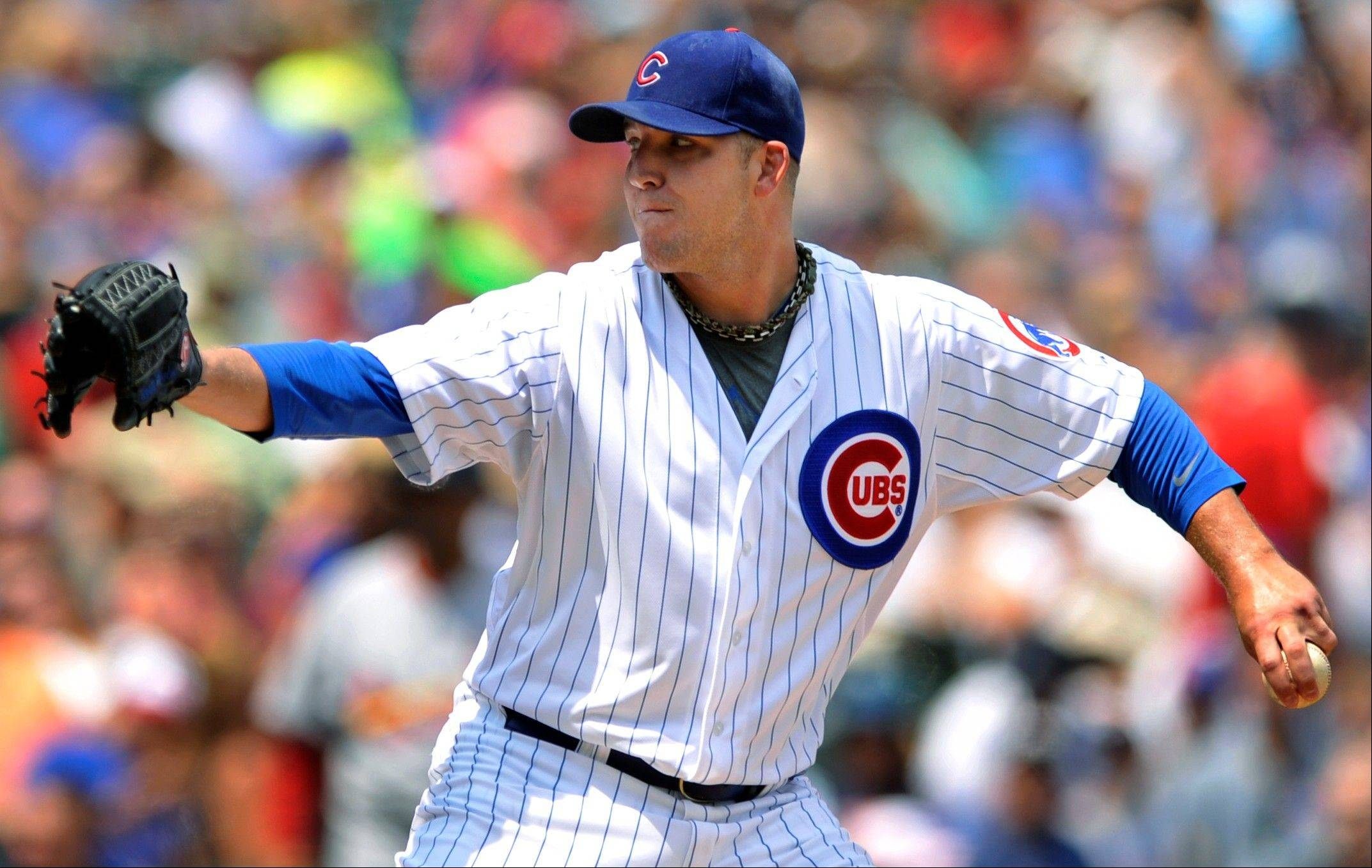 Cubs starter Paul Maholm delivers a pitch Sunday against the St. Louis Cardinals in the first inning at Wrigley Field.