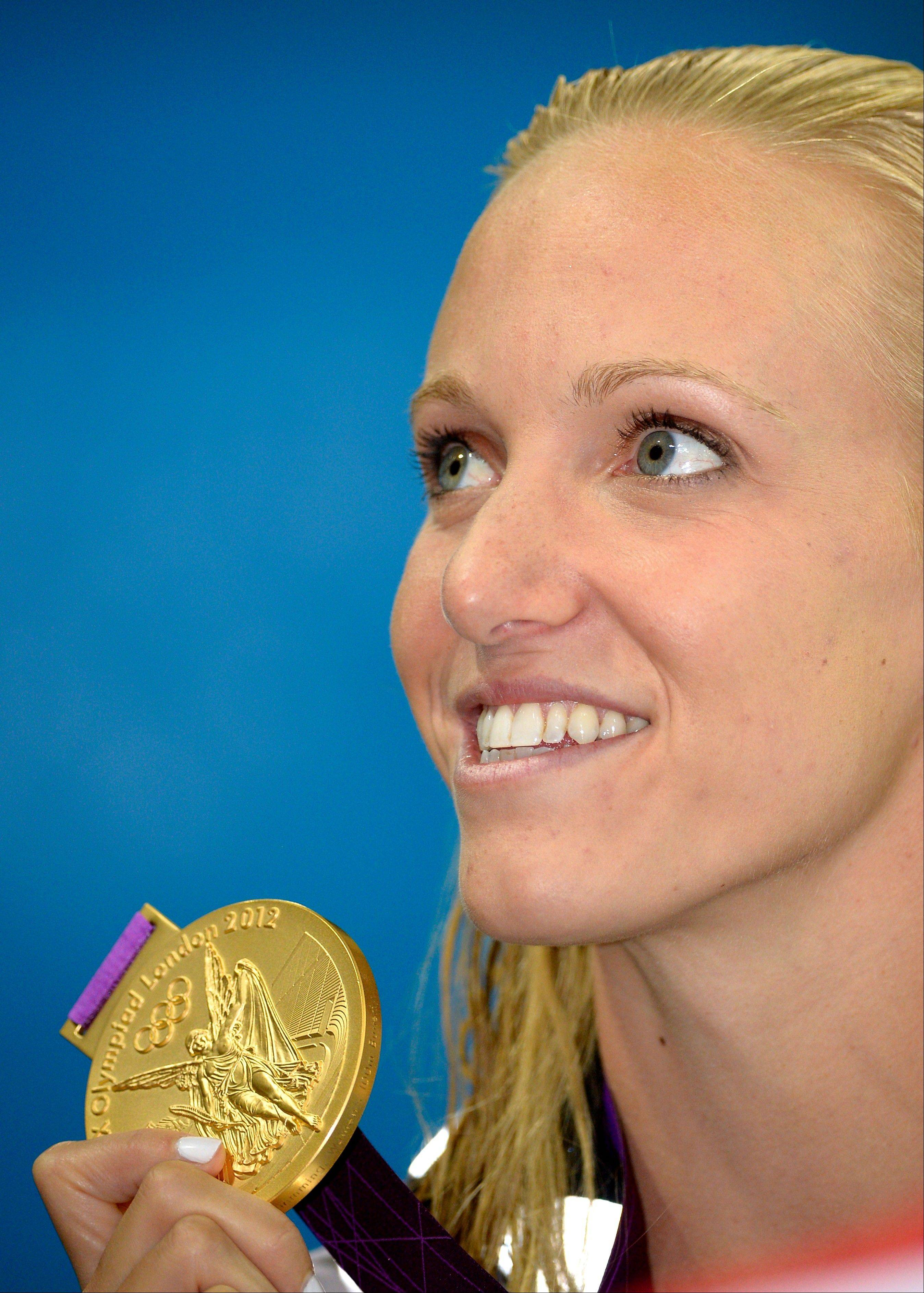 United States' Dana Vollmer poses with her gold medal for the women's 100-meter butterfly swimming final at the Aquatics Centre in the Olympic Park during the 2012 Summer Olympics in London, Sunday. Vollmer set a new world record with a time of 55.98.