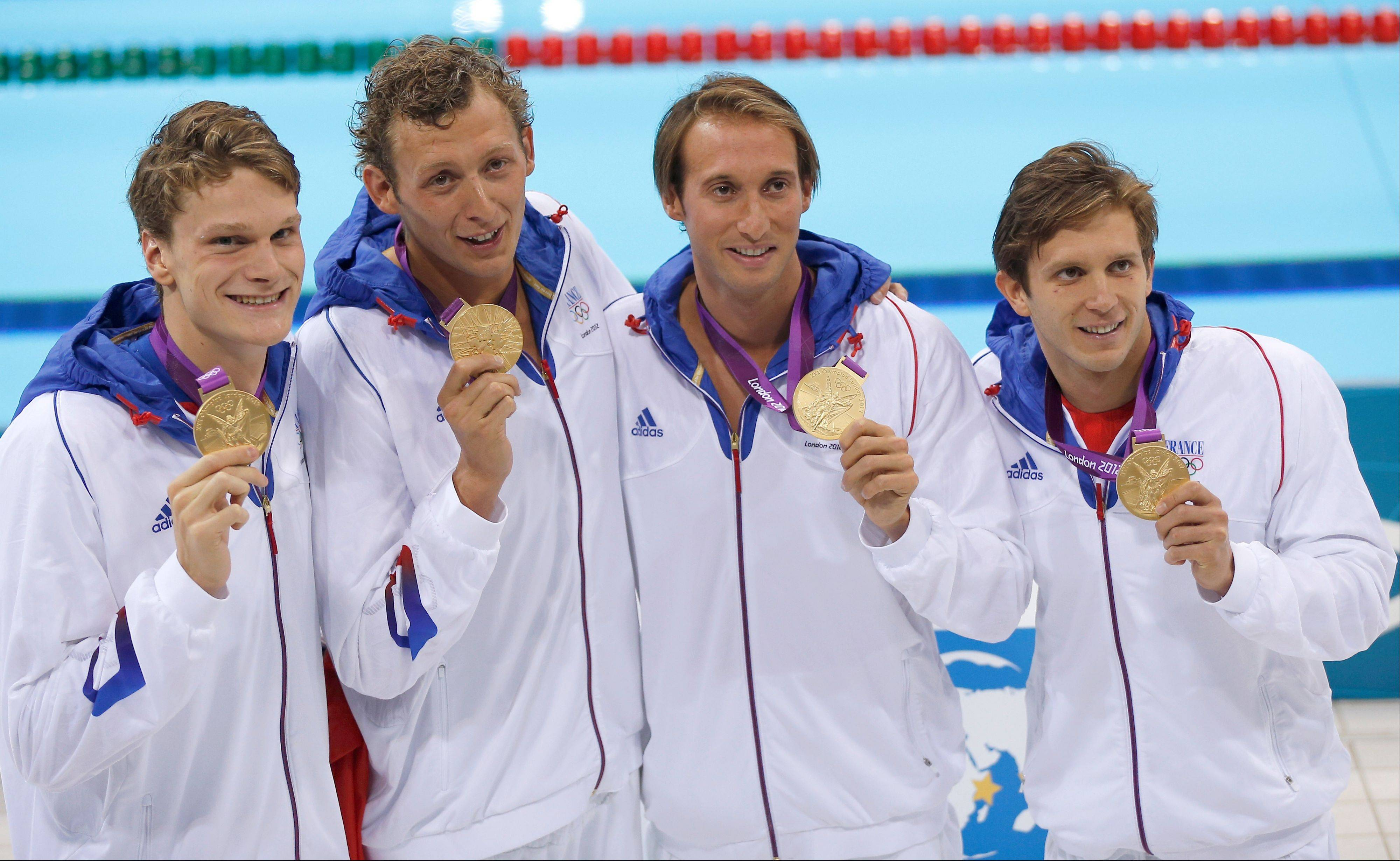 France's men's relay swim team members -- from left, Yannick Agnel, Amaury Leveaux, Fabien Gilot, and Clement Lefert -- hold their gold medals after their win in the men's 4x100-meter freestyle relay final at the Aquatics Centre in the Olympic Park during the 2012 Summer Olympics in London.