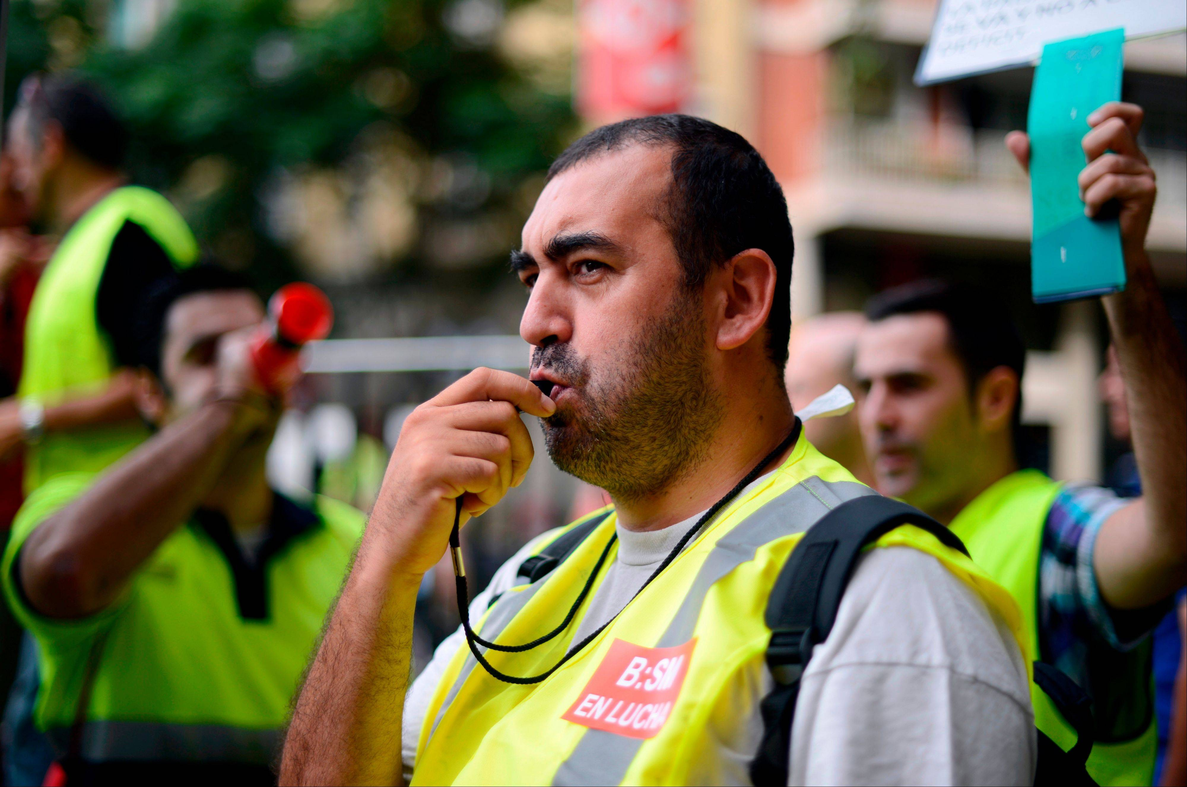 A Government employee protests against cuts in Barcelona, Spain, Monday, July 30, 2012.