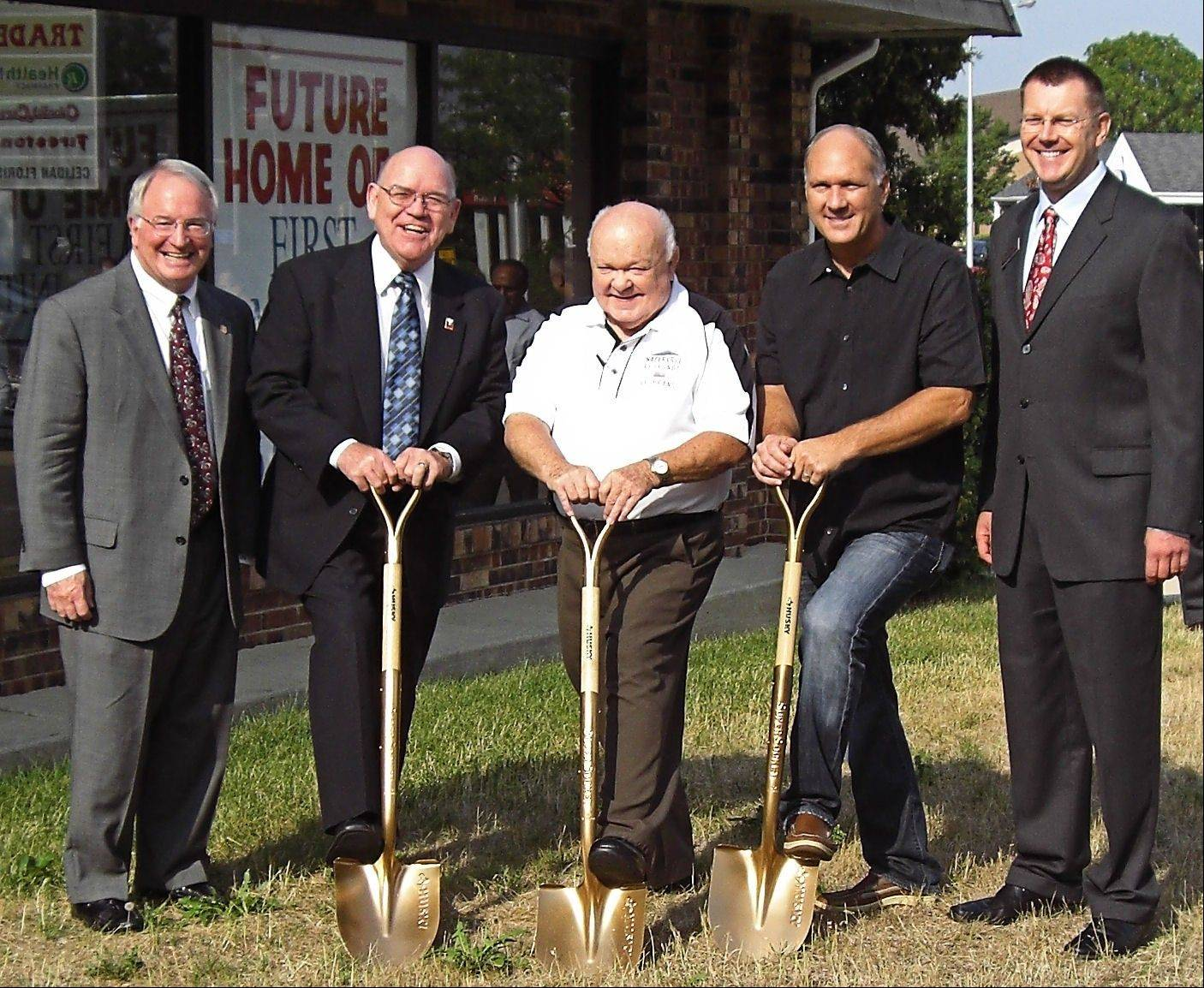 J. Patrick Benton, Market President of First Community Bank — Naperville, from left, Doug Krause, Naperville councilman; Naperville Mayor A. George Pradel; Steve Chirico, Naperville councilman; and Scott Wehrli, member of the bank's board, break ground on the new site.