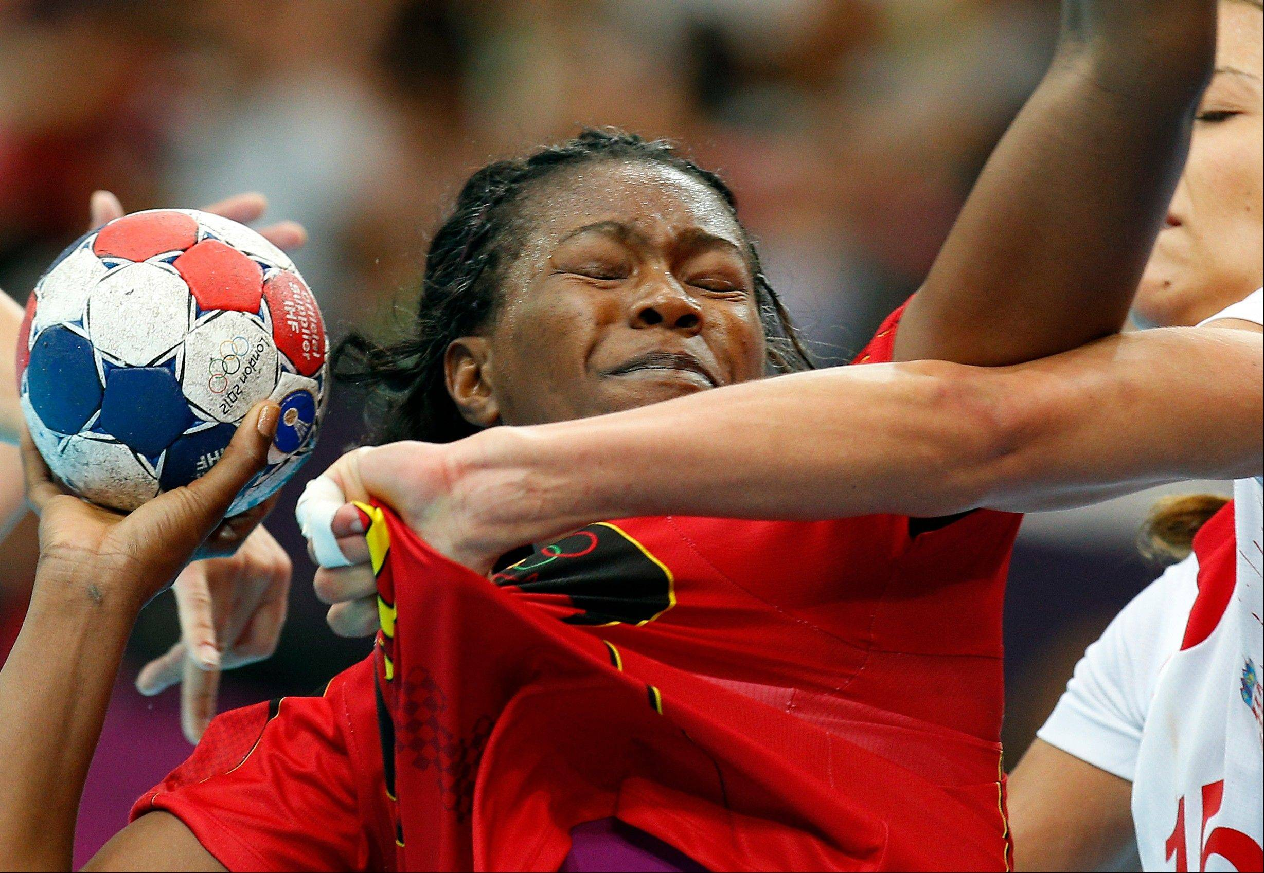 Marcelina Kiala of Angola, left, is challenged by Croatia�s Andrea Penezic during their women�s handball preliminary match at the 2012 Summer Olympics, Monday, July 30, 2012, in London.