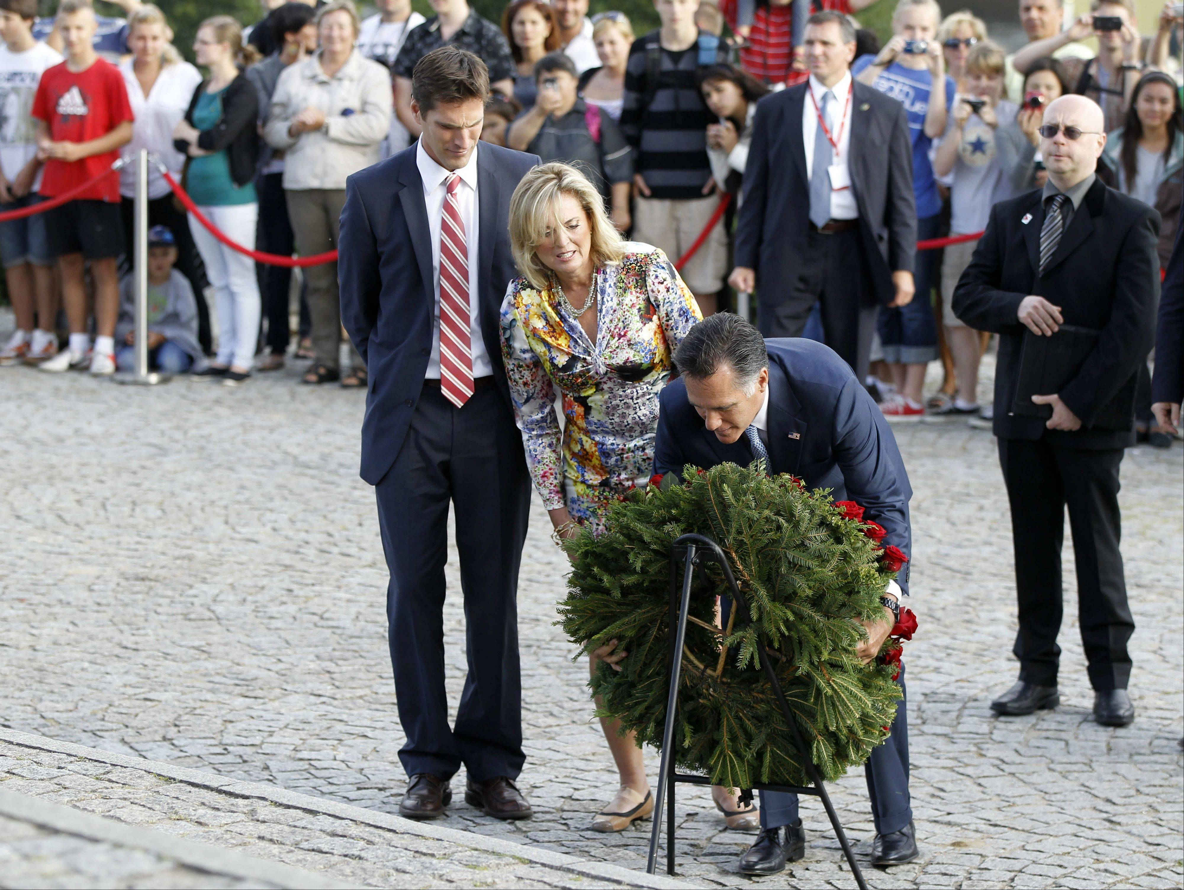 Republican presidential candidate, former Massachusetts Gov. Mitt Romney, his wife Ann, and son Josh, laying a wreath during their visit to the World War II Memorial Westerplatte, in Gdansk, Poland, Monday.