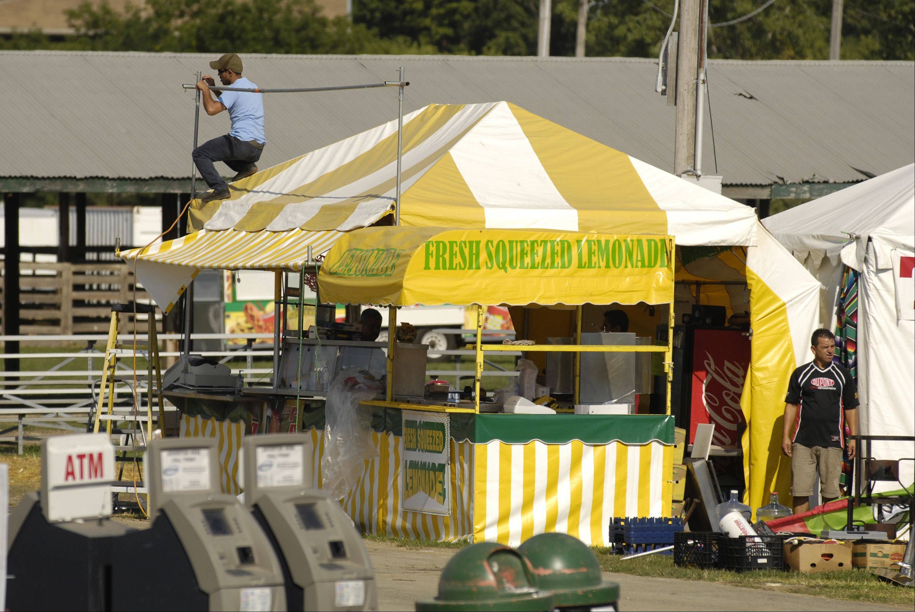 Crews take down tents and clean up trash Monday after the closing of the 2012 DuPage County Fair. Officials reported a significant increase in attendance this year.