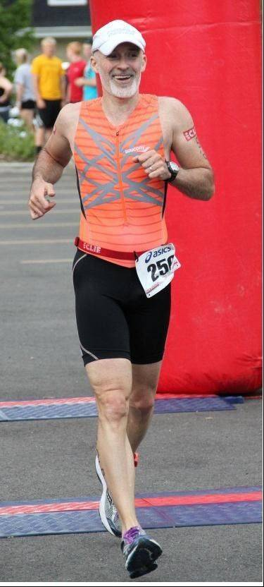 Dean Hewson crosses the finish line at the July 8 Splash, Pedal, Dash Triathlon.