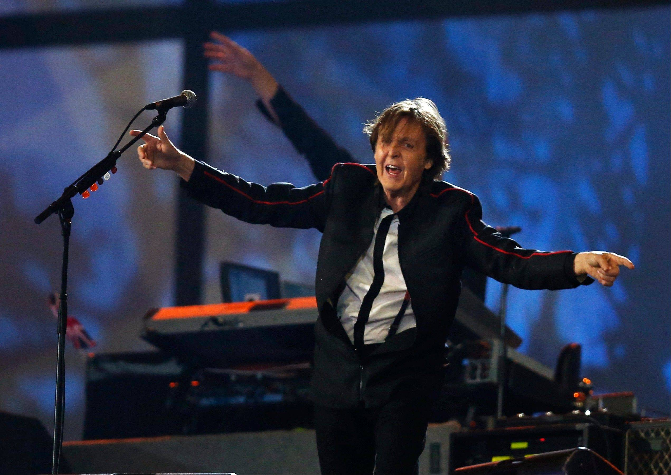 Paul McCartney performs during the Opening Ceremony at the 2012 Summer Olympics on Friday in London.