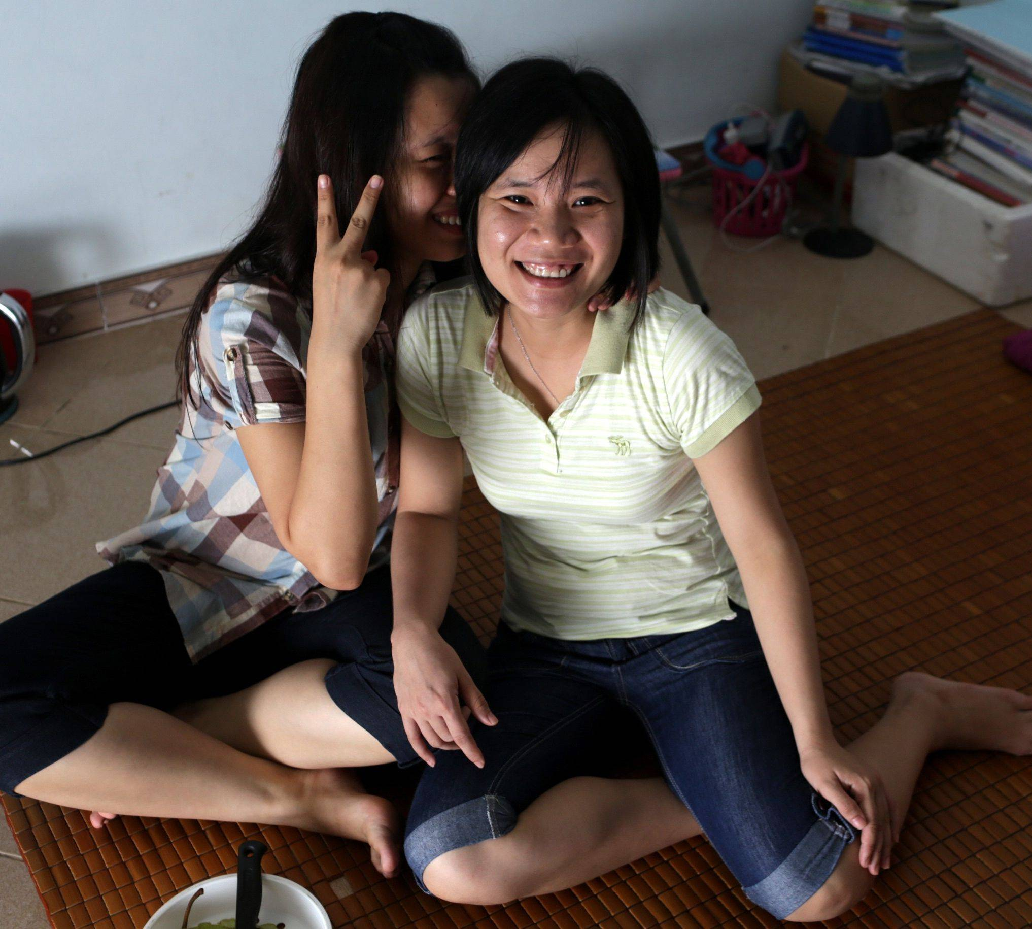 Nguyen Thi Chi, 20, left, and Dinh Thi Hong Loan, 30, pose in their apartment in Hanoi. The couple has dated for more than two years and plans to marry next month.