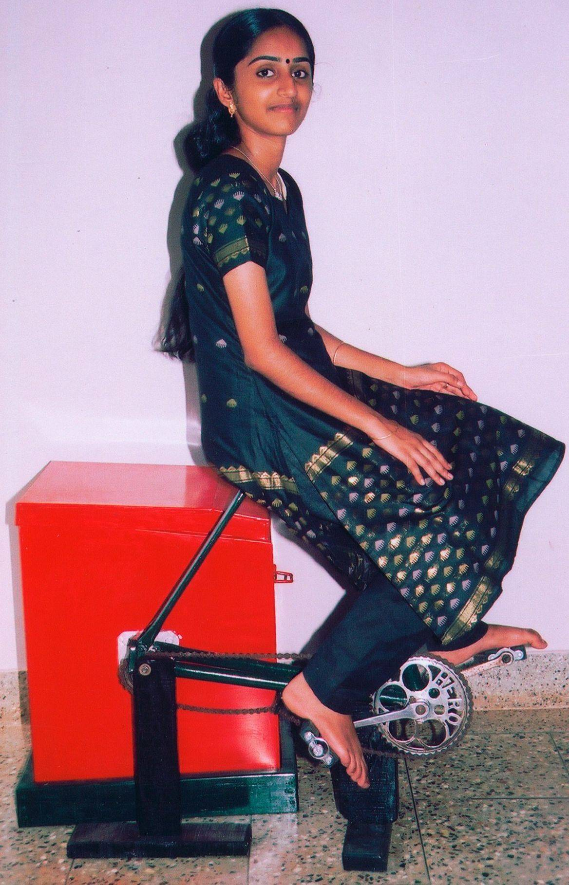 Remya Jose of India demonstrates the pedal-powered washing machine she invented. She was forced to do laundry by hand when her mother became sick because her family had no washing machine. So she invented a washing machine/exercise bike that is cheap to make and requires no electricity.