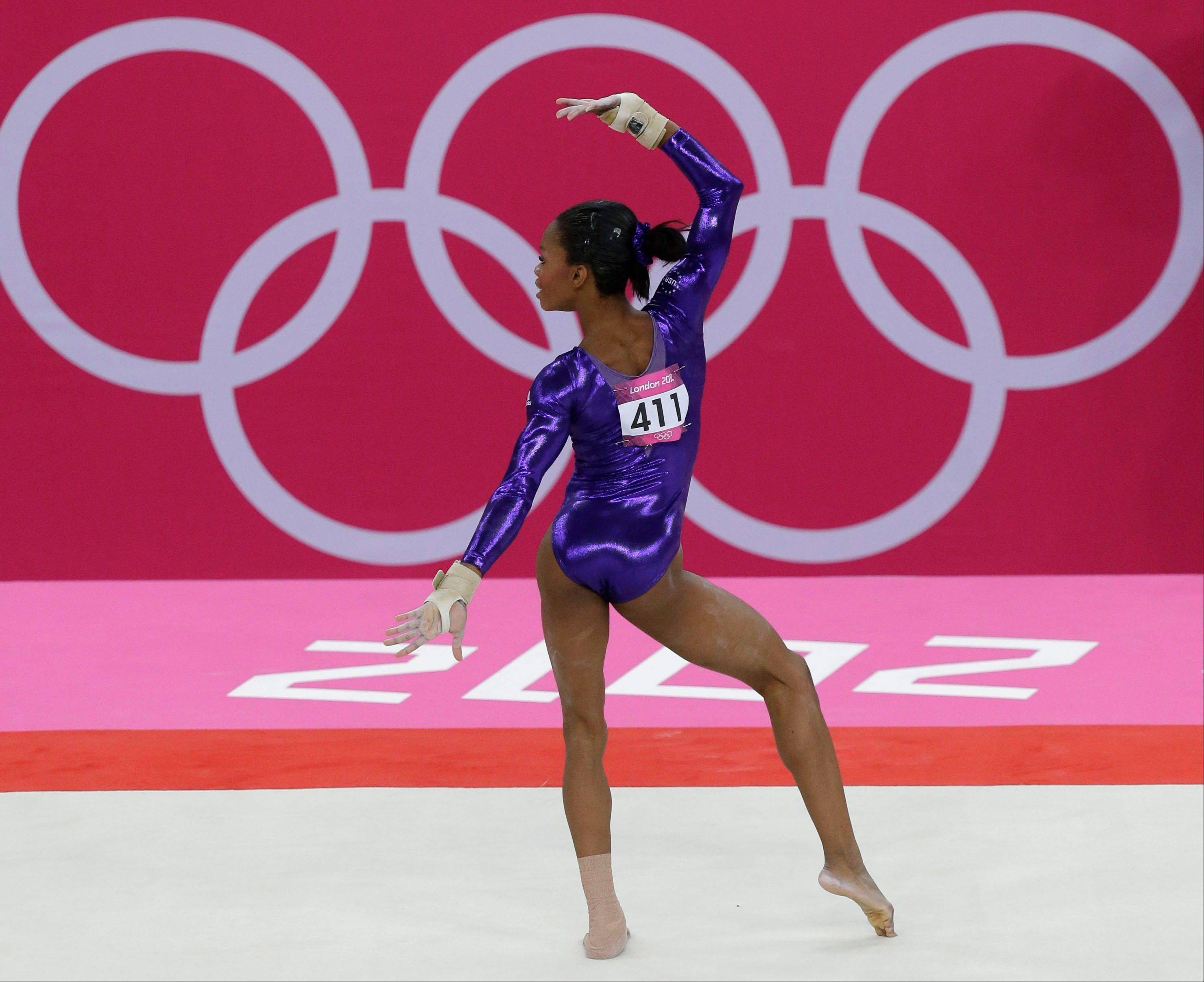 U.S. gymnast Gabrielle Douglas performs on the floor during the Artistic Gymnastic women�s qualifications at the 2012 Summer Olympics, Sunday, July 29, 2012, in London.