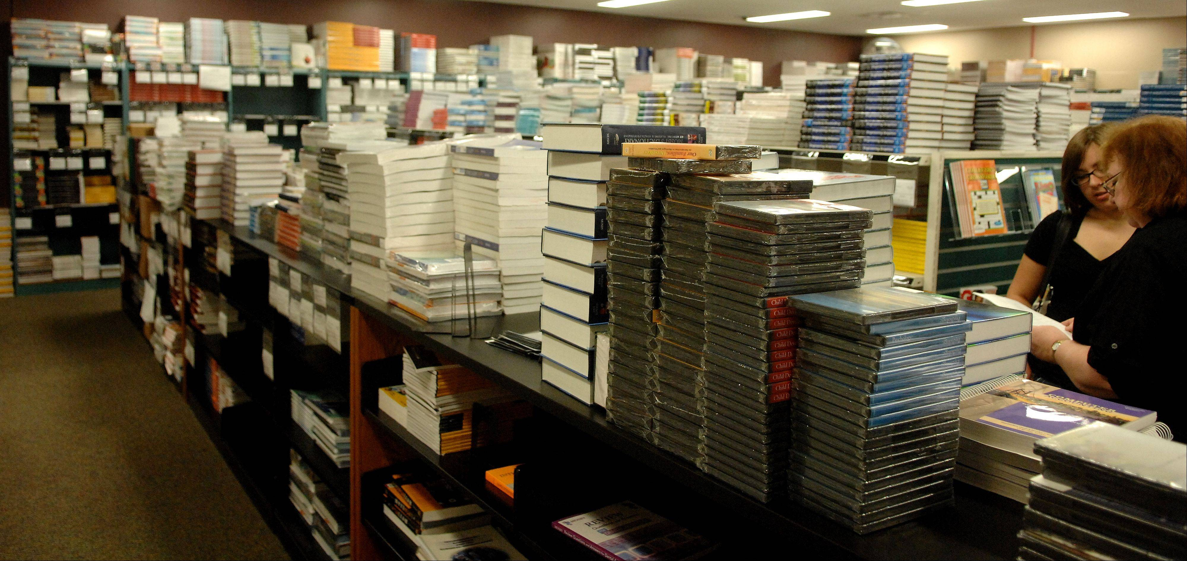 The vast expanse of traditional paper textbooks at the Elgin Community College bookstore could one day be replaced by e-books. ECC is piloting the use of e-books for students in the nursing program. Instead of lugging around heavy books that cost hundreds of dollars, students in the program will be able to download all of their course materials on to a tablet or laptop.
