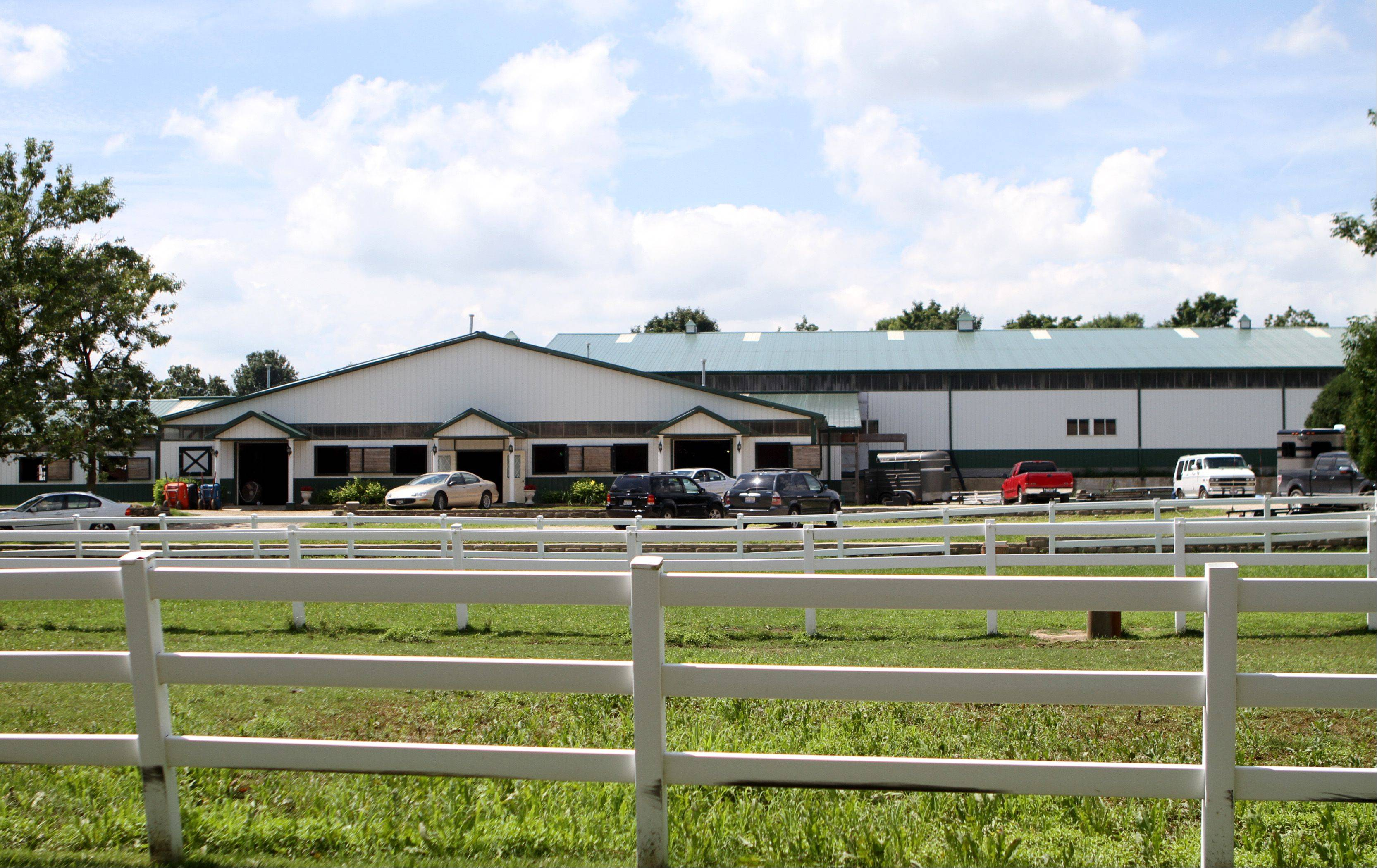 Oakwood Farms in Barrington Hills, which has a barn large enough for 60 horses, has long been a subject of public debate about commercial horse boarding on residential property. But could the topic determine the outcome of the next village board election?
