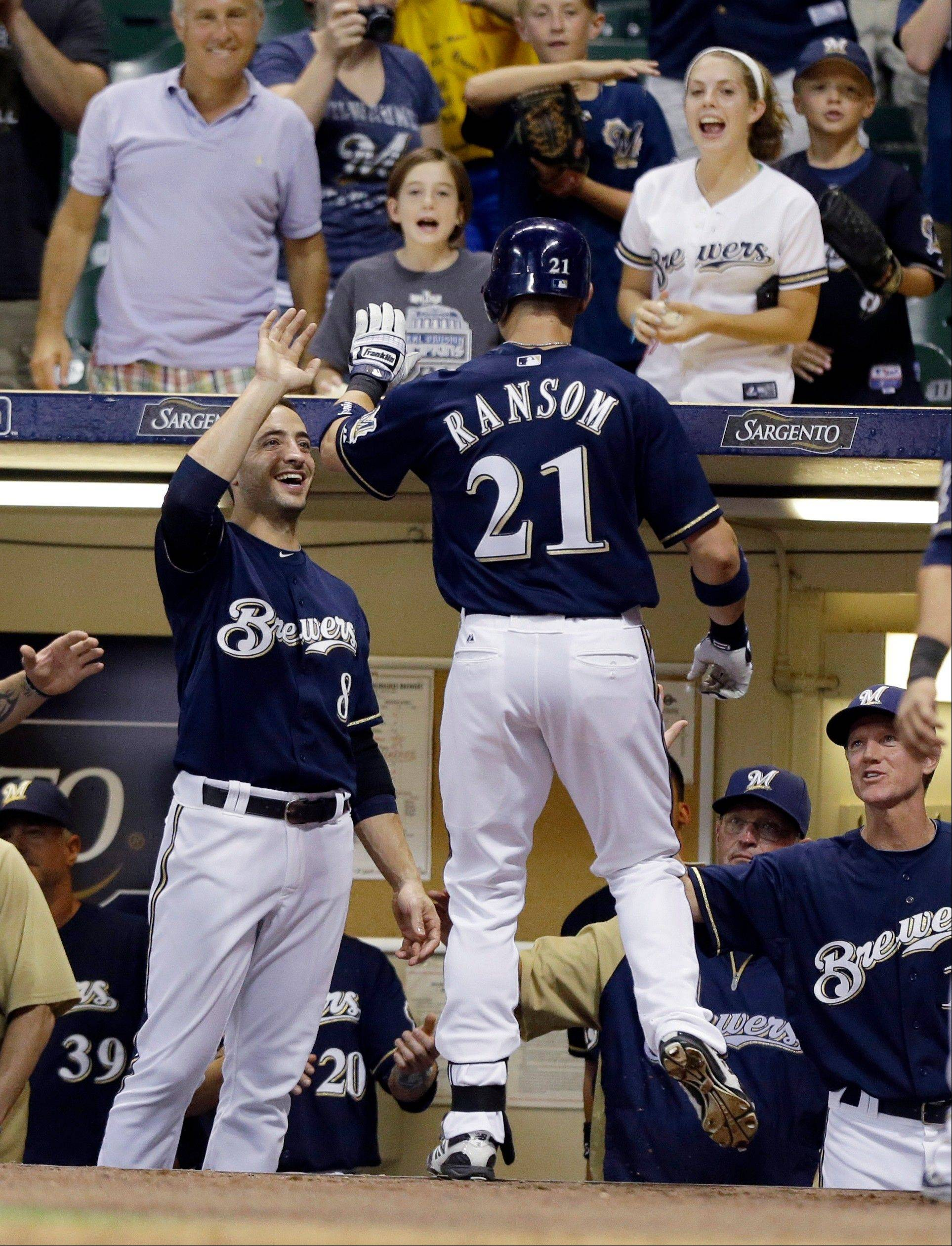 Fans cheer and teammates congratulate the Brewers� Cody Ransom after his three-run home run against the Houston Astros on Monday in Milwaukee.