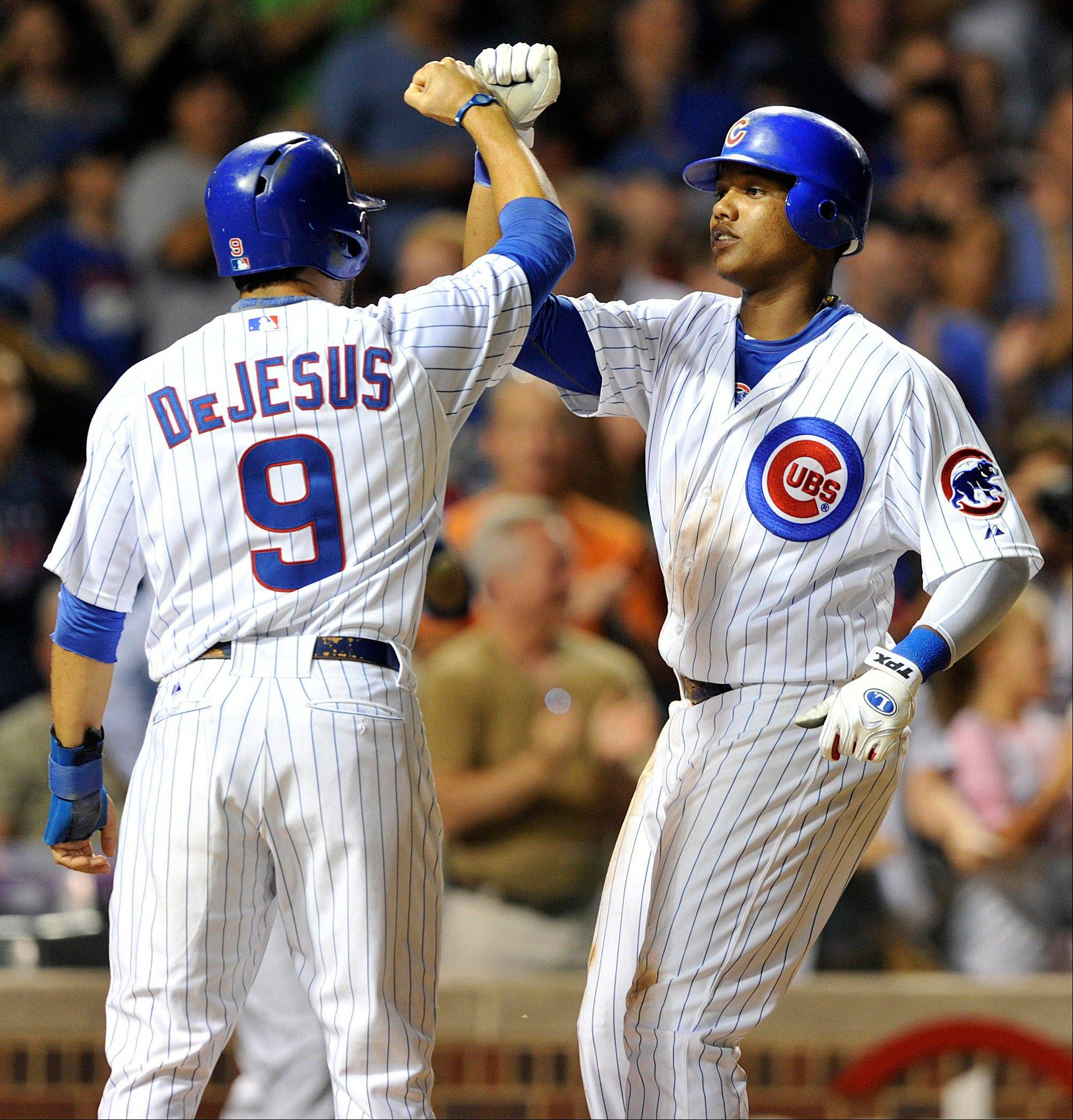 Cubs outfielder David DeJesus congratulates Starlin Castro after Castro�s two-run home run Monday against the Pittsburgh Pirates at Wrigley Field.
