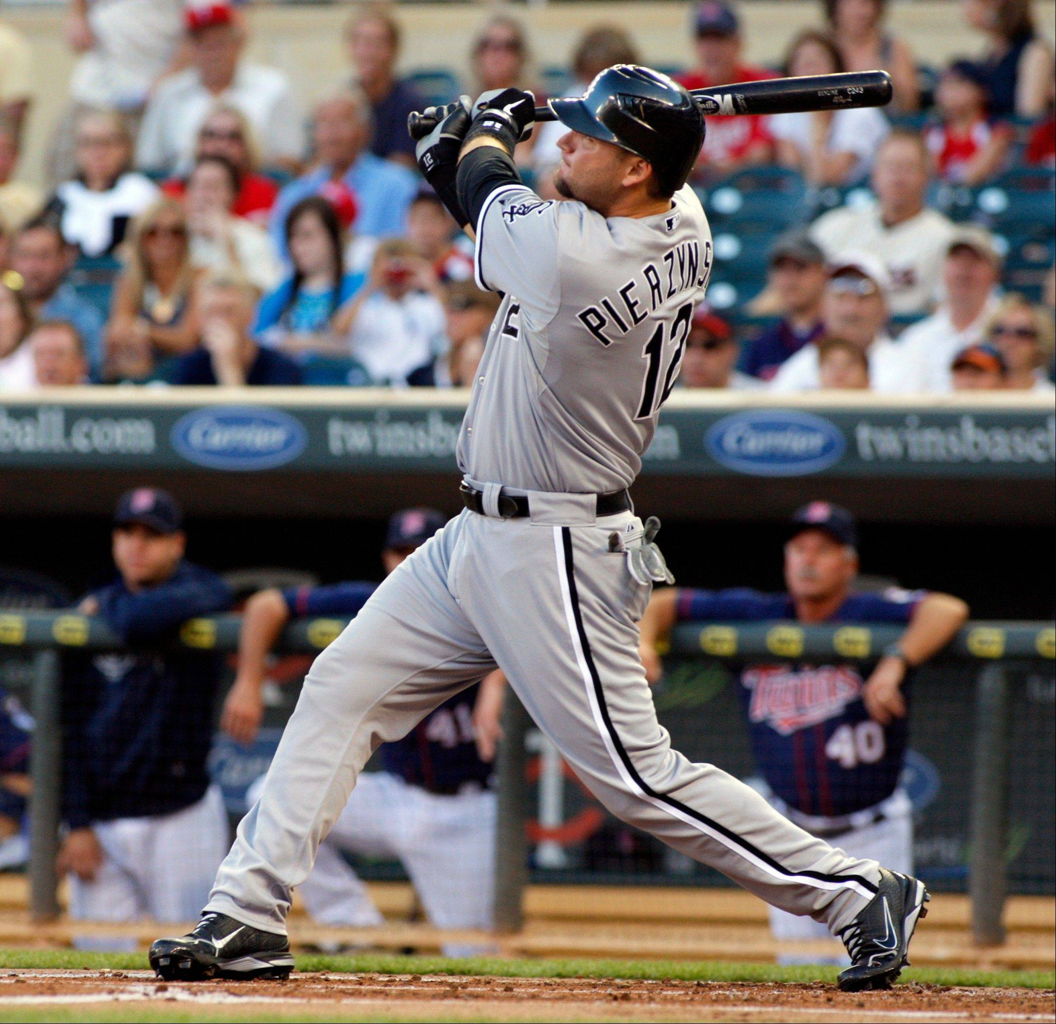 White Sox catcher A.J. Pierzynski watches his three-run home run during Monday�s first inning in Minneapolis.