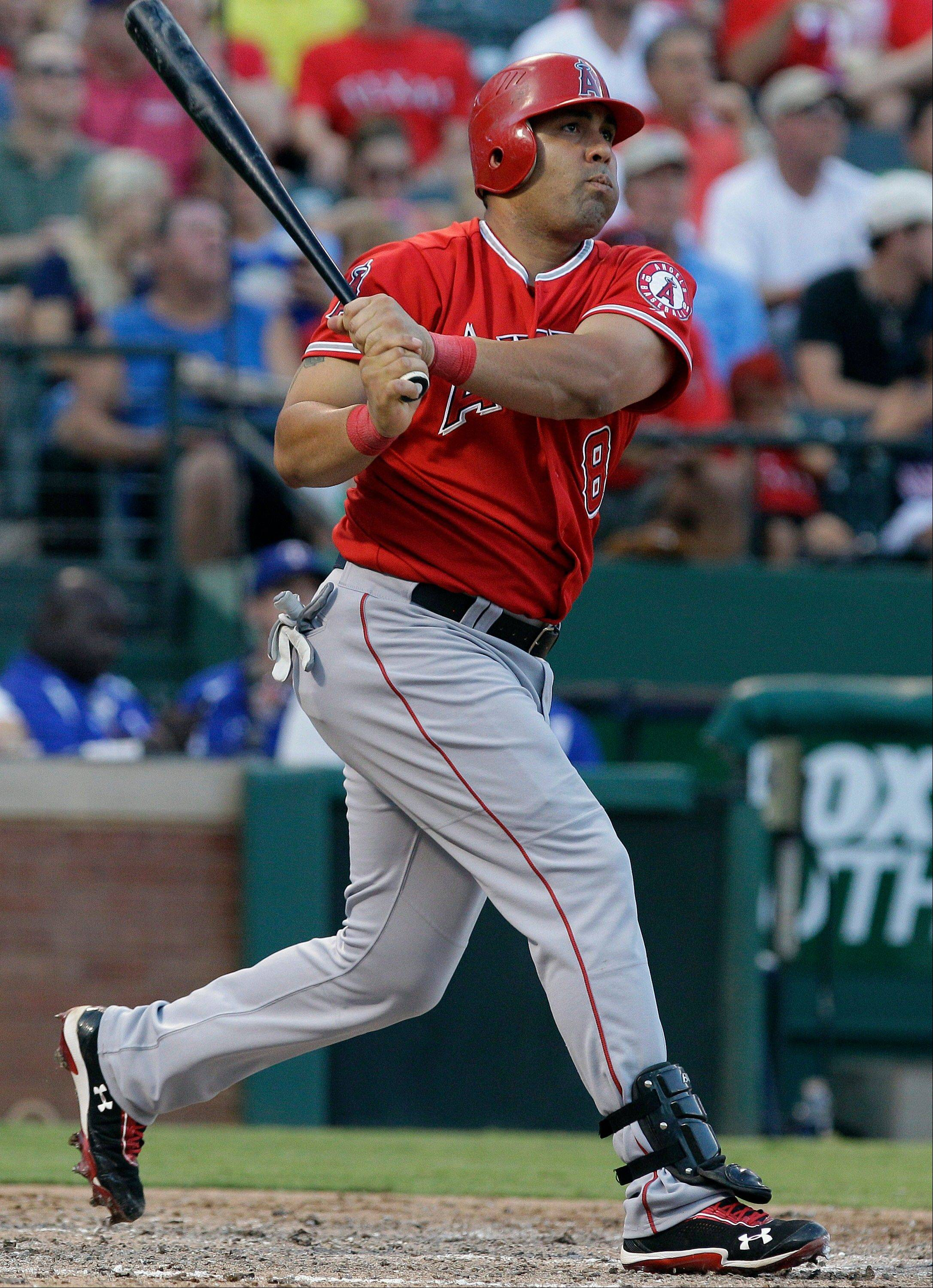 Los Angeles Angels designated hitter Kendrys Morales, batting as a lefty, watches his two-run homer fly during the sixth inning Monday in Arlington, Texas.