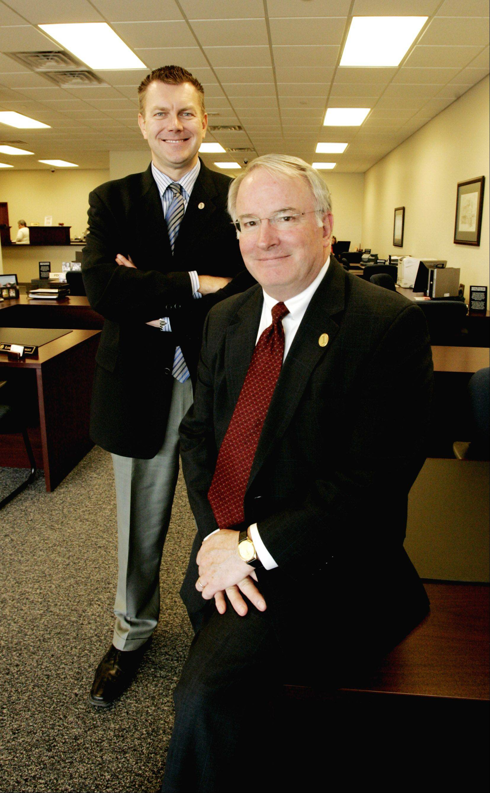 Scott Wehrli, left and First Community Bank President J. Patrick Benton helped to open the bank in 2008.