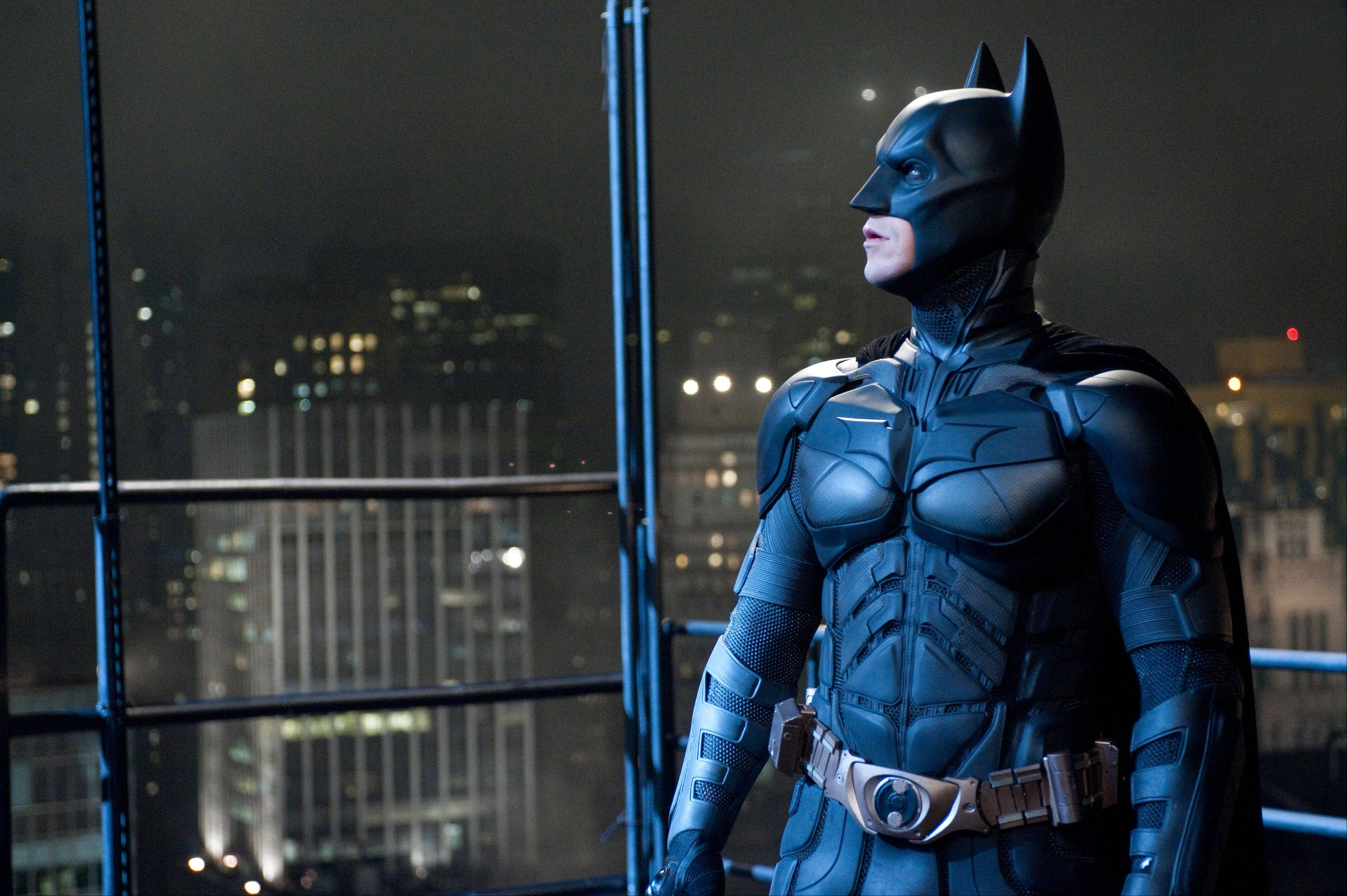 """The Dark Knight Rises"" starring Christian Bale stayed atop the box office for the second straight weekend, making just over $64 million. But it's lagging behind the numbers of its predecessor, 2008's ""The Dark Knight."""