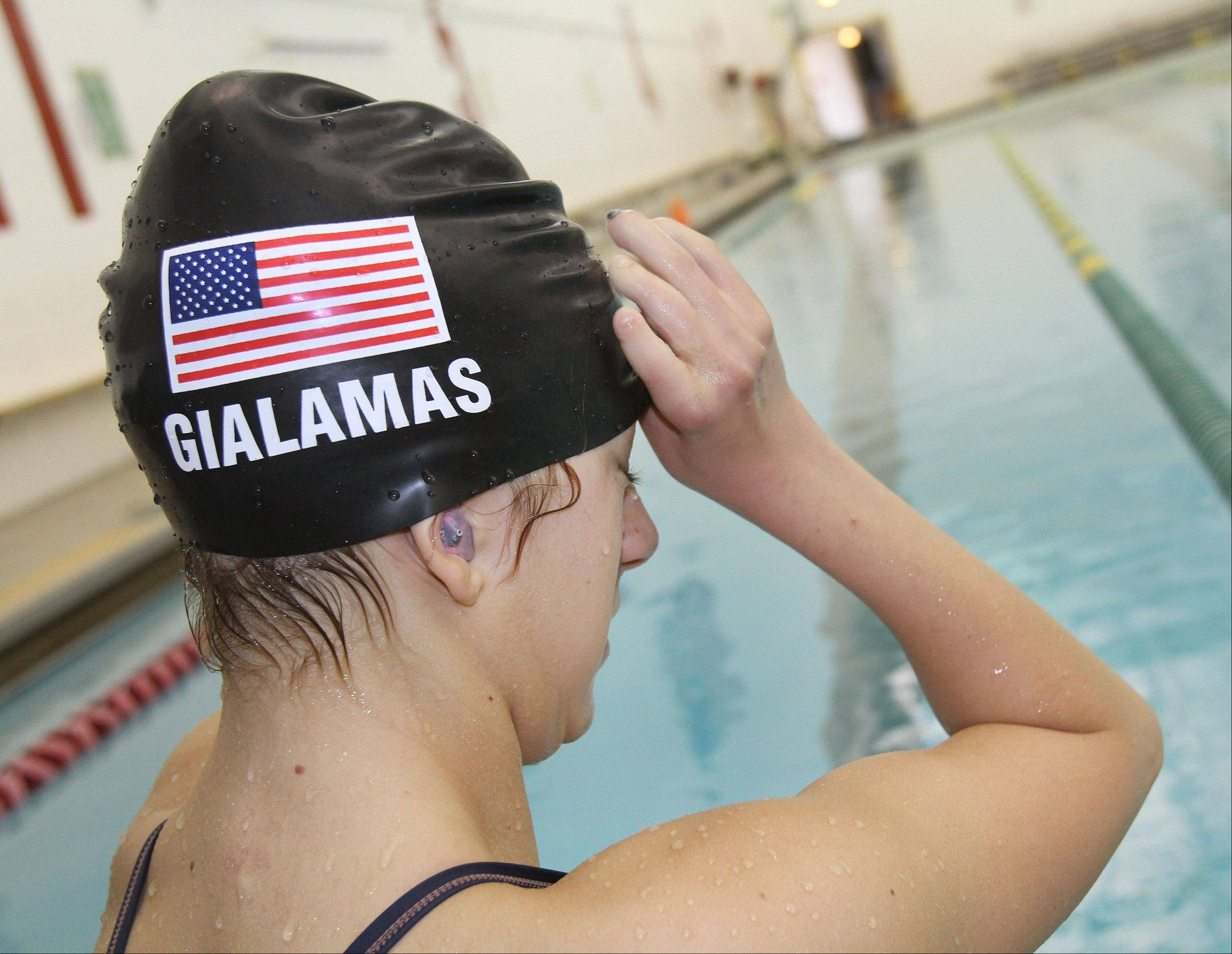 """I used to have caps with a number or maybe my name if I was lucky,"" Paralympian swimmer Alyssa Gialamas said. ""Now I get the American flag and my name."""