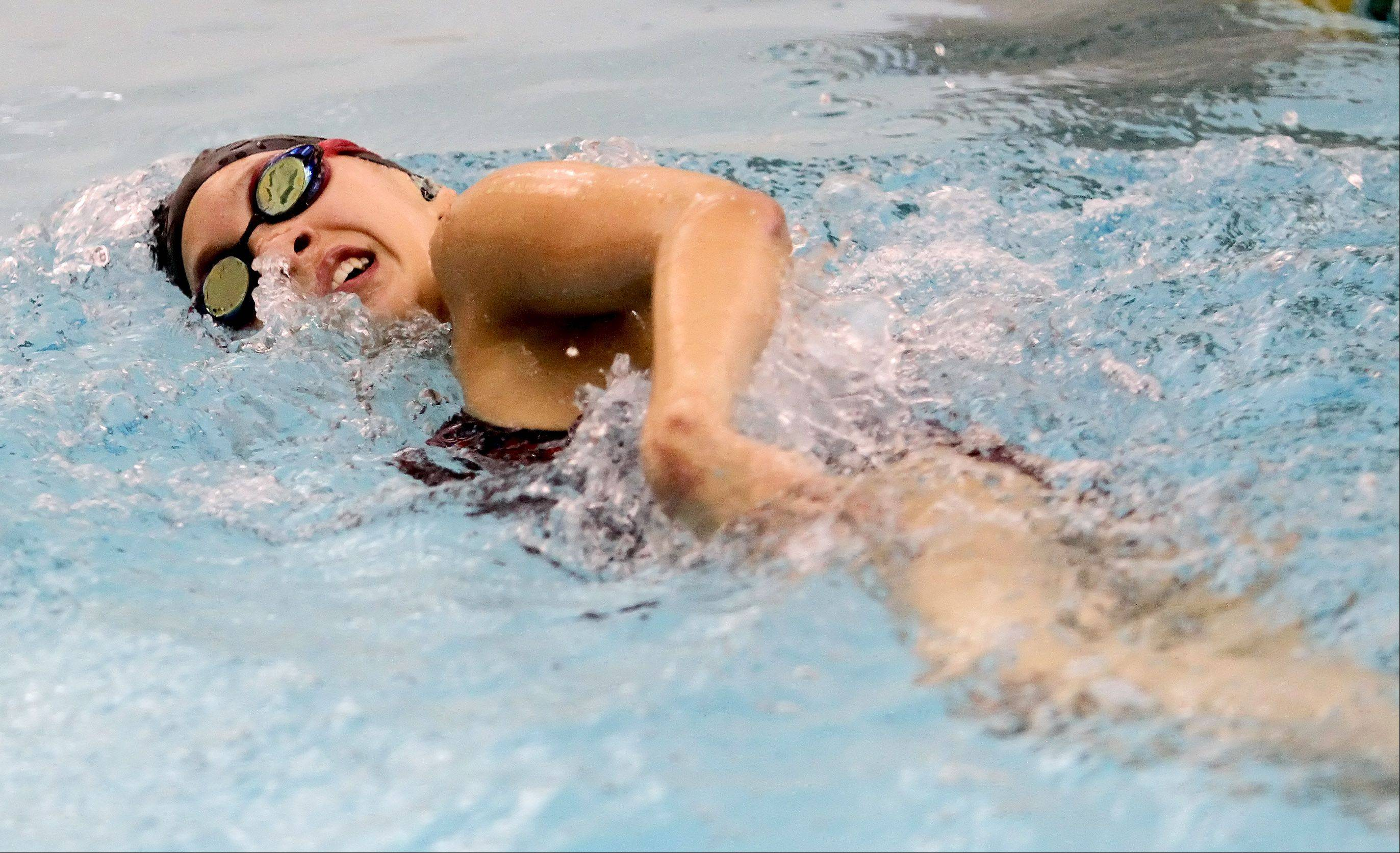 Alyssa Gialamas of Naperville trains daily at the Waubonsie Valley High School pool. She will be competing in this year's Paralympic Games in London.