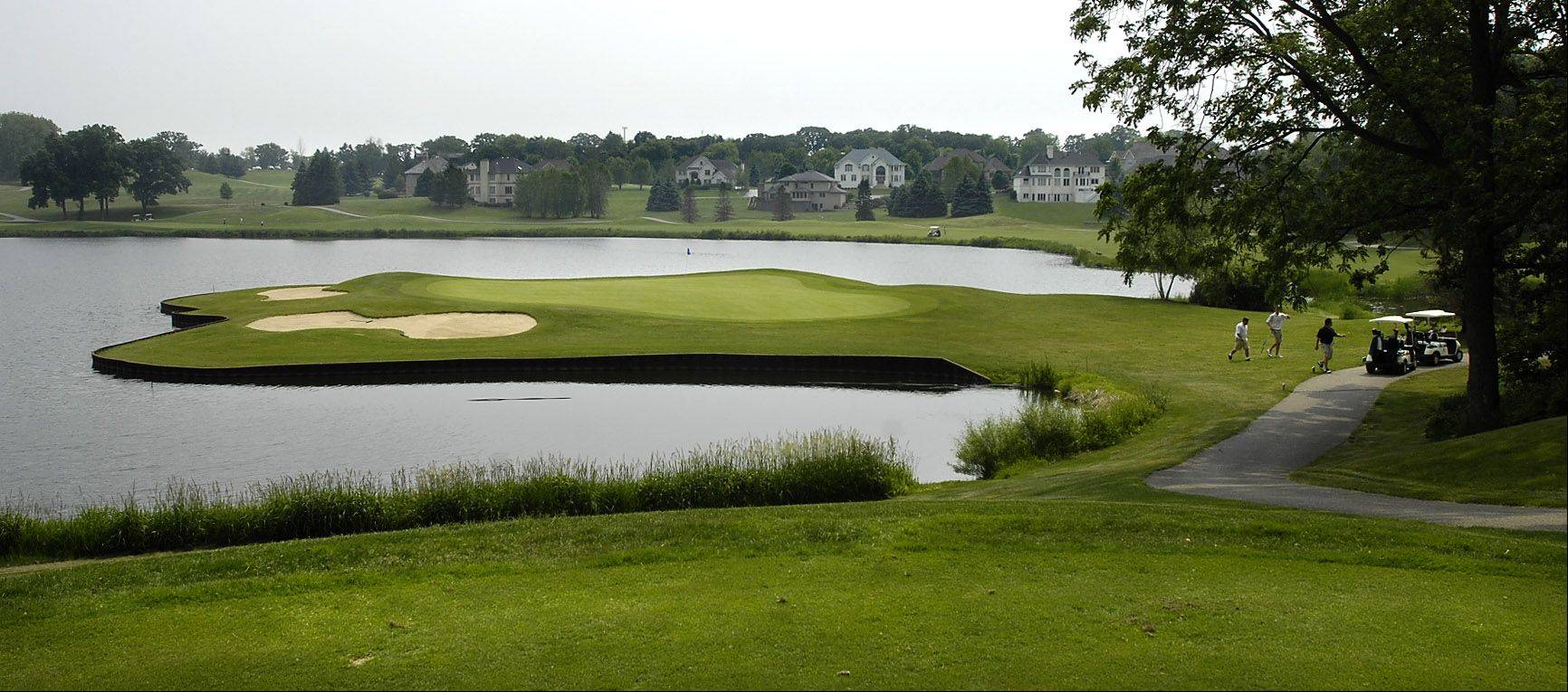 This tricky, short par three to a peninsula green is part of Chalet Hills Golf Club in Cary. The course is for sale, and the Cary Park District officials are considering buying it.