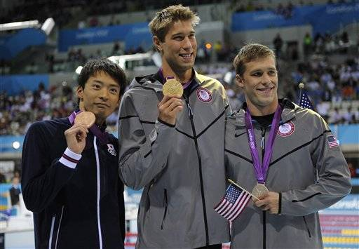 From left, Japan's Ryosuke Irie, United States' Matthew Grevers and United States' Nick Thoman pose with their medals for the men's 100-meter backstroke swimming final at the Aquatics Centre in the Olympic Park during the 2012 Summer Olympics in London, Monday, July 30, 2012. Grevers won gold, Thoman silver and Irie bronze.