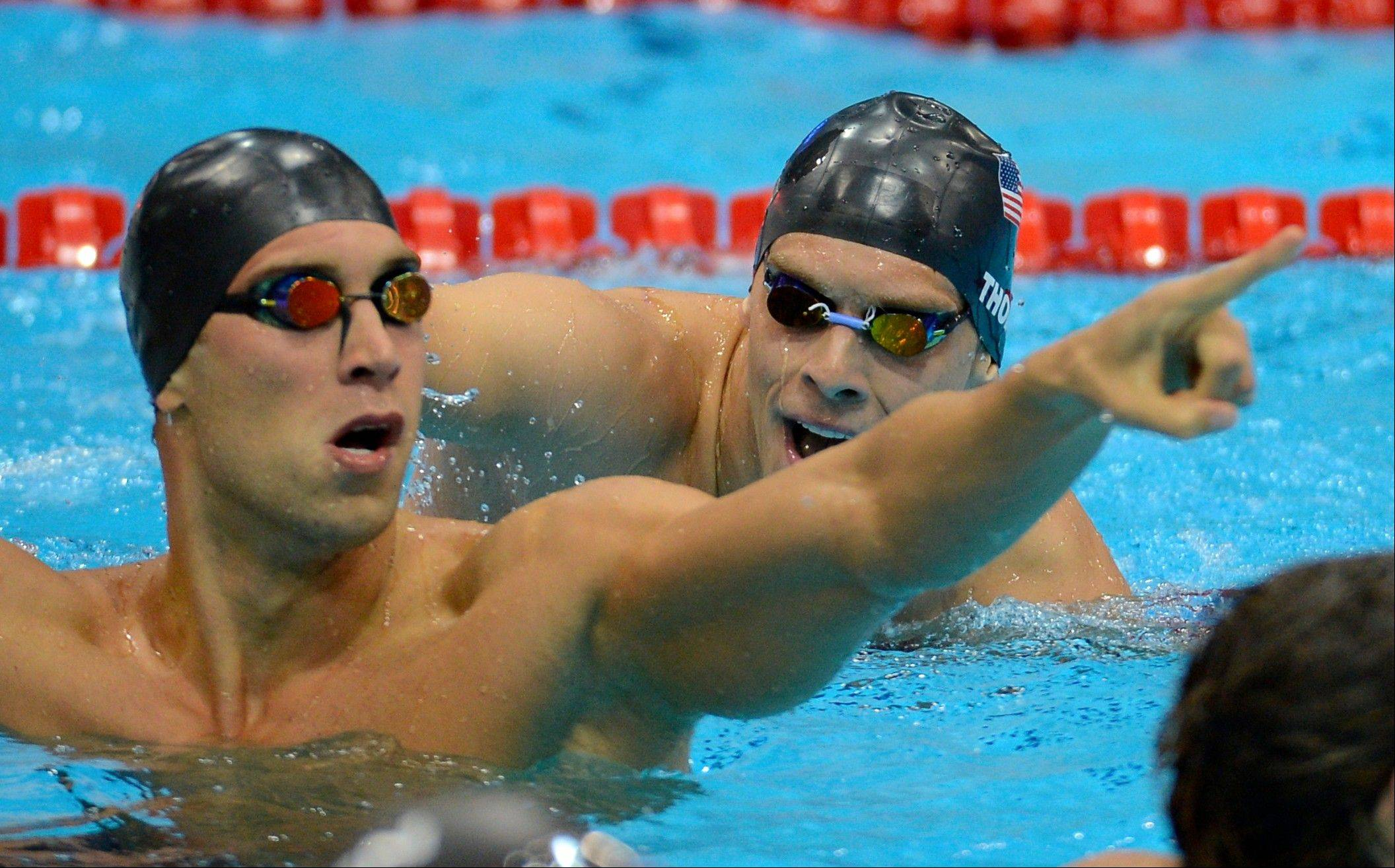 United States' Matthew Grevers, left, and United States' Nick Thoman react after the men's 100-meter backstroke swimming final at the Aquatics Centre in the Olympic Park during the 2012 Summer Olympics in London, Monday, July 30, 2012. Grevers won gold, Thoman silver.
