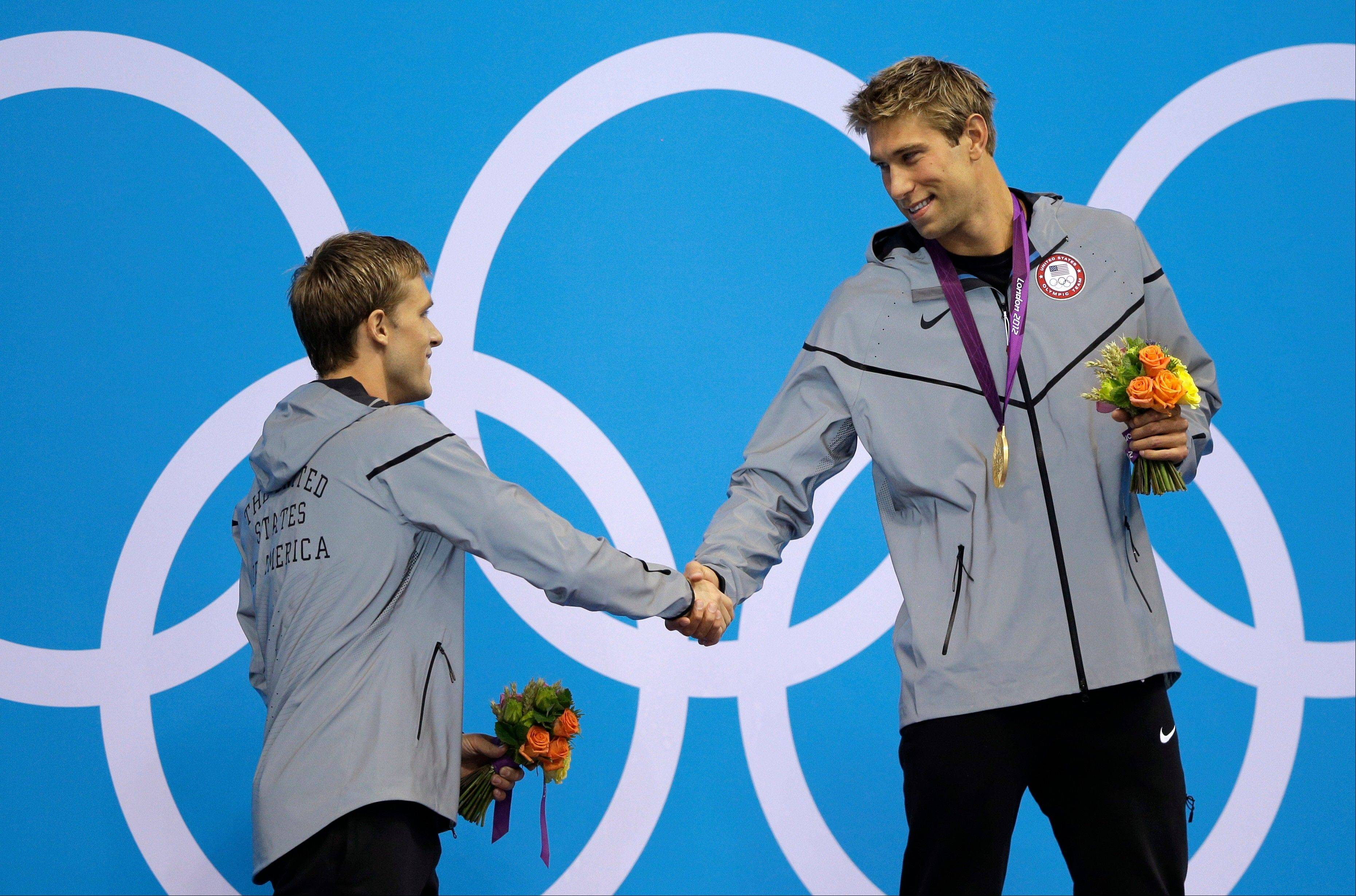 United States silver medalist Nick Thoman, left, shakes hands with gold medalist Matthew Grevers, right, during a ceremony following their wins in the men's 100-meter backstroke swimming final at the Aquatics Centre in the Olympic Park during the 2012 Summer Olympics in London, Monday, July 30, 2012.