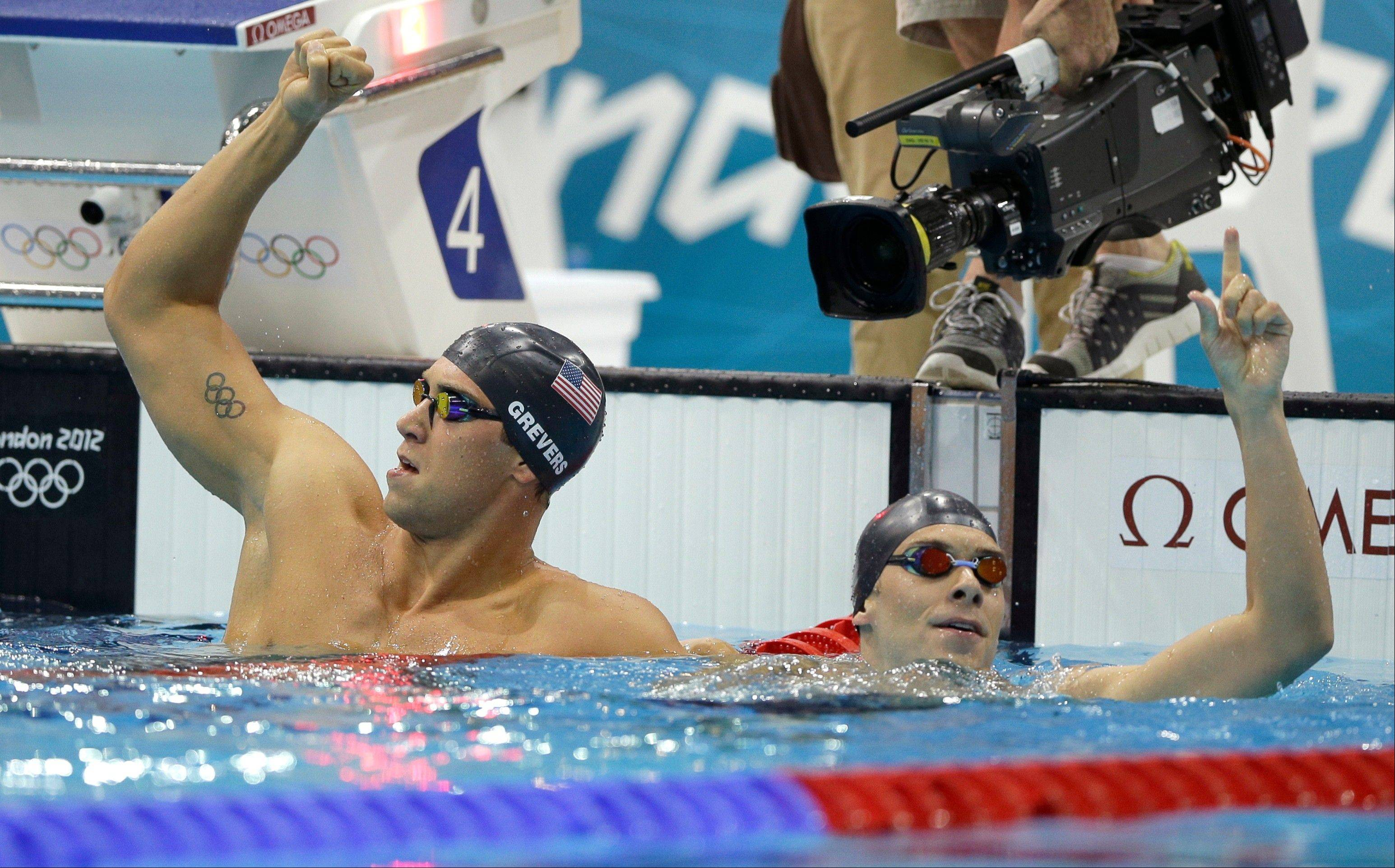 United States' Matthew Grevers, left, and teammate Nick Thoman celebrate after Grevers' gold medal win in the men's 100-meter backstroke swimming final at the Aquatics Centre in the Olympic Park during the 2012 Summer Olympics in London, Monday, July 30, 2012.