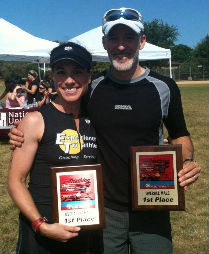 Judie Refvik and Dean Hewson stand with their awards after completing the Splash, Pedal, Dash Triathlon.