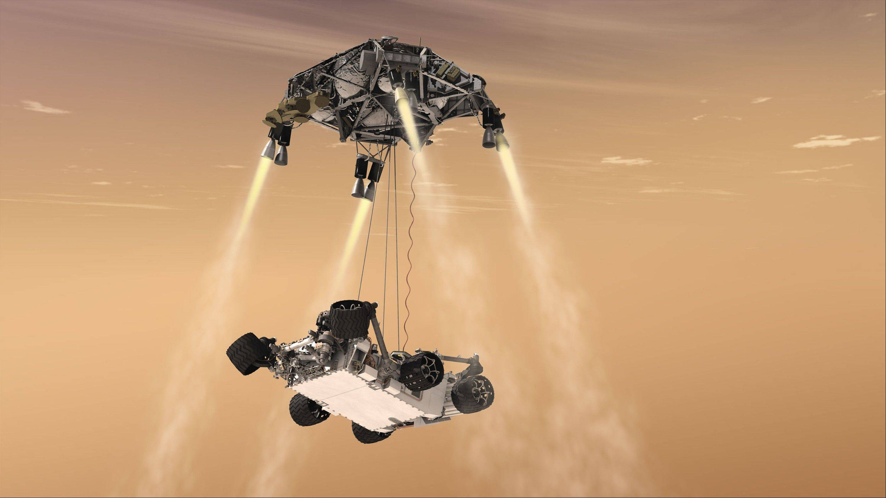 "In this 2011 file artist's rendering provided by NASA/JPL-Caltech, a ""sky crane"" lowers the Mars Science Laboratory Curiosity rover onto the surface of Mars. After traveling 8 1/2 months and 352 million miles, Curiosity will attempt a landing on Mars the night of Aug. 5, 2012."