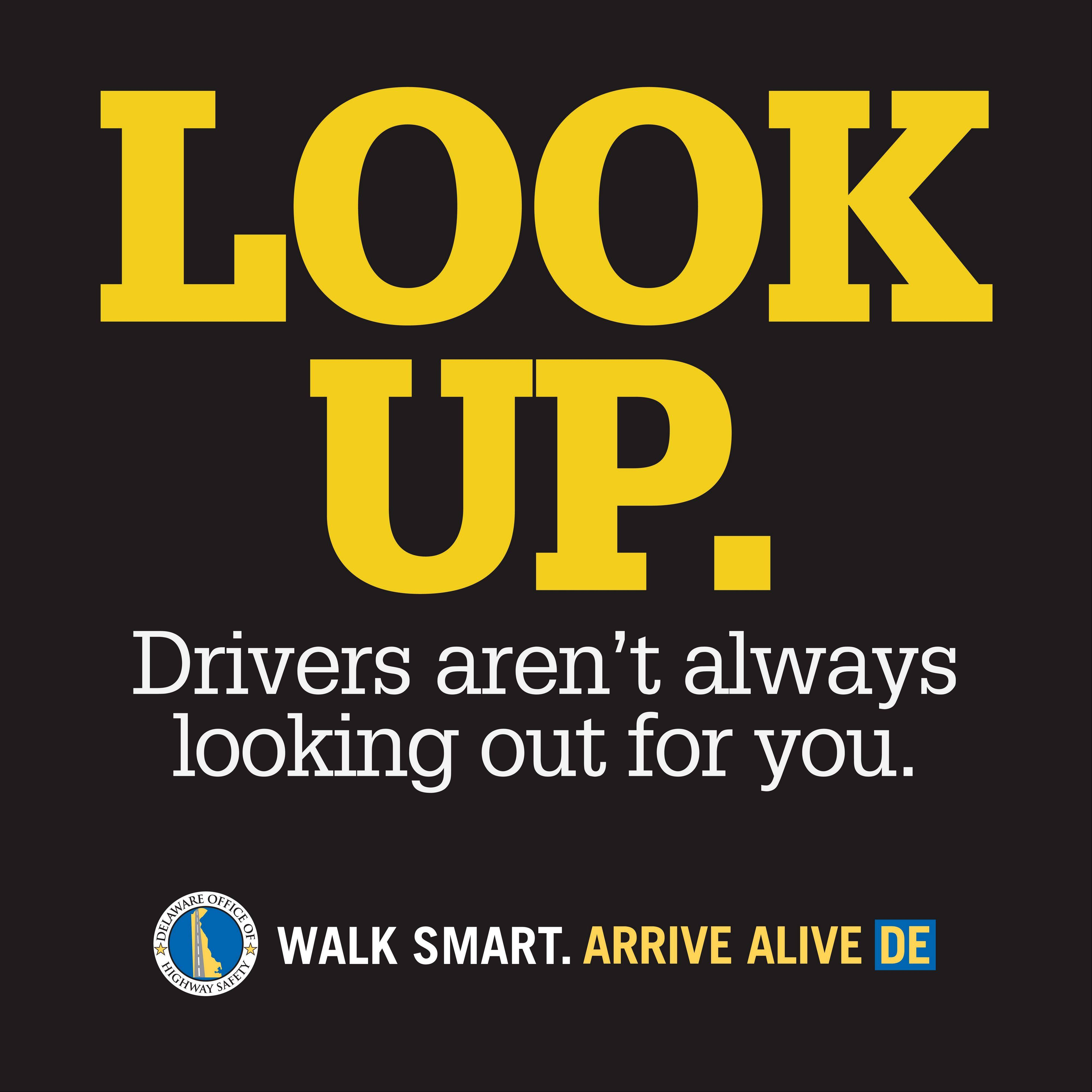 A Delaware State Office of Highway Safety decal aimed at getting distracted pedestrians to look up from their mobile devices and watch where they�re walking. The decals are 2 feet by 2 feet, made of nonskid material.