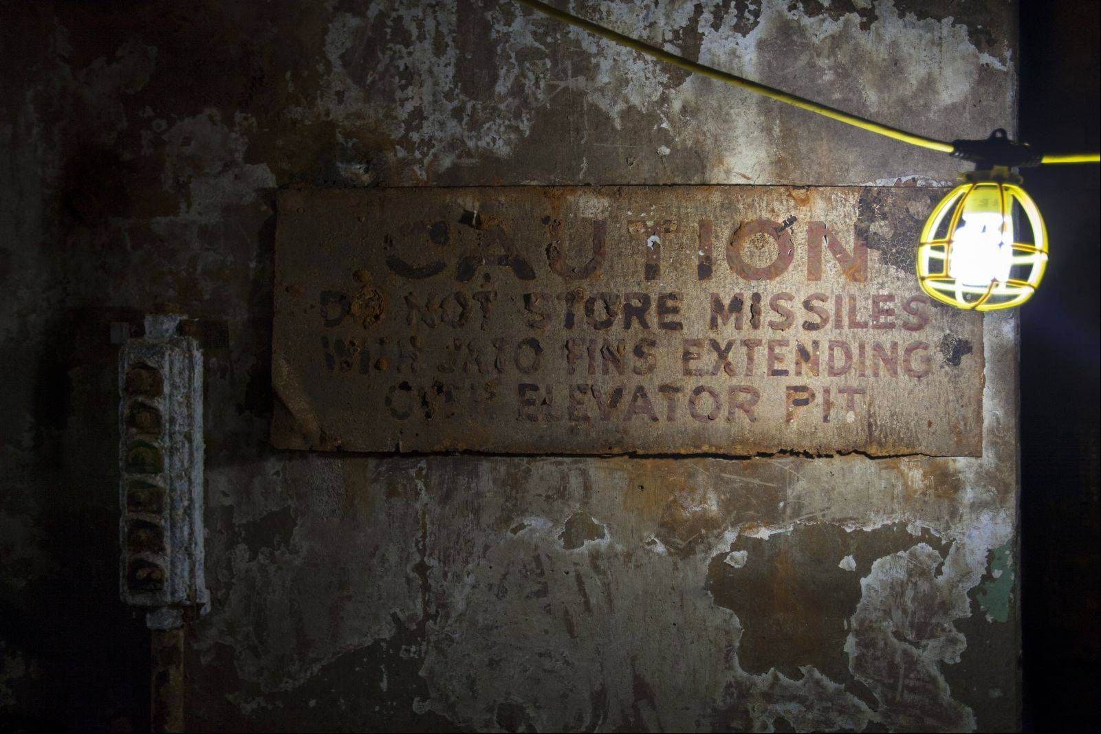 A rusted caution sign from the Cold War still hangs on a wall in the Nike missile magazine in Vernon Hills.