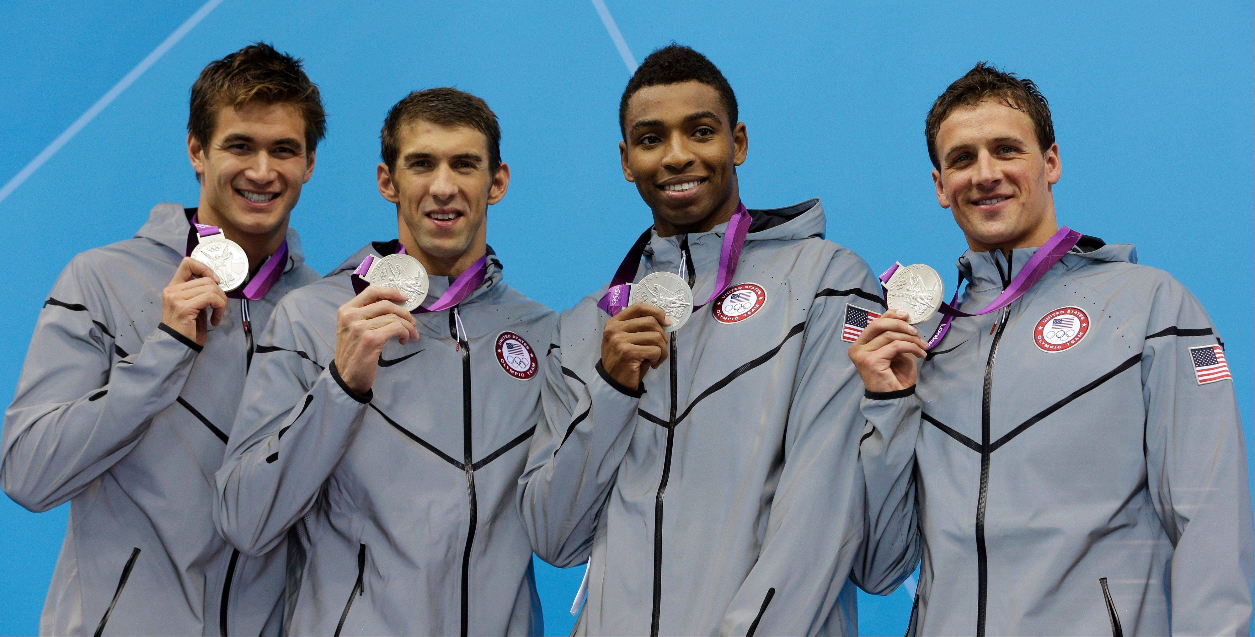 From left, United States' Nathan Adrian, United States' Michael Phelps, United States' Cullen Jones and United States' Ryan Lochte pose with their medals for the men's 4x100-meter freestyle relay final Sunday at the Aquatics Centre in the Olympic Park during the 2012 Summer Olympics in London.