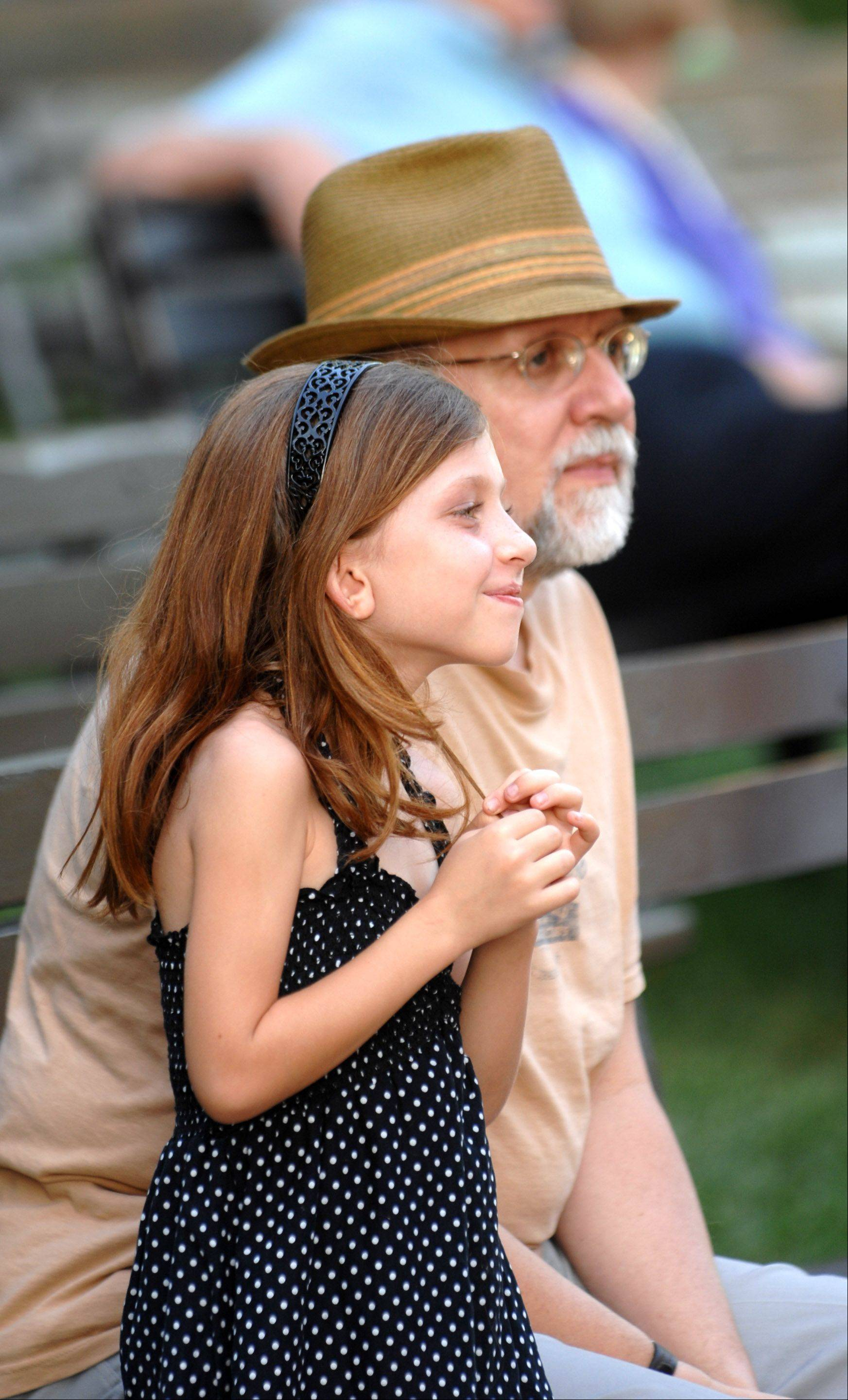B.J. Slinger and his granddaughter Abigail, 8, both of Wheaton enjoy the show during the 13th annual Wheaton Band Festival at Memorial Park Friday in Wheaton. Well over 200 people took part in this event.