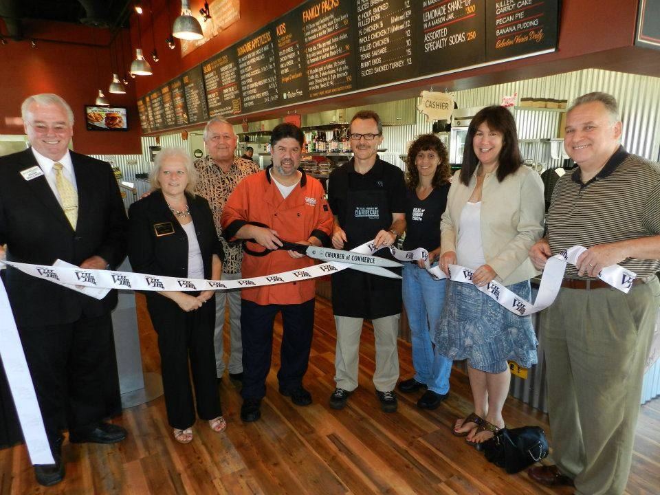 Real Urban BBQ owner Jeff Shapiro cuts the ribbon to celebrate the new restaurant's Grand Opening in Vernon Hills, along with Mike Allison, Village of Vernon Hills; Alese Campbell, GLMV Chamber of Commerce, and other chamber and business leaders.