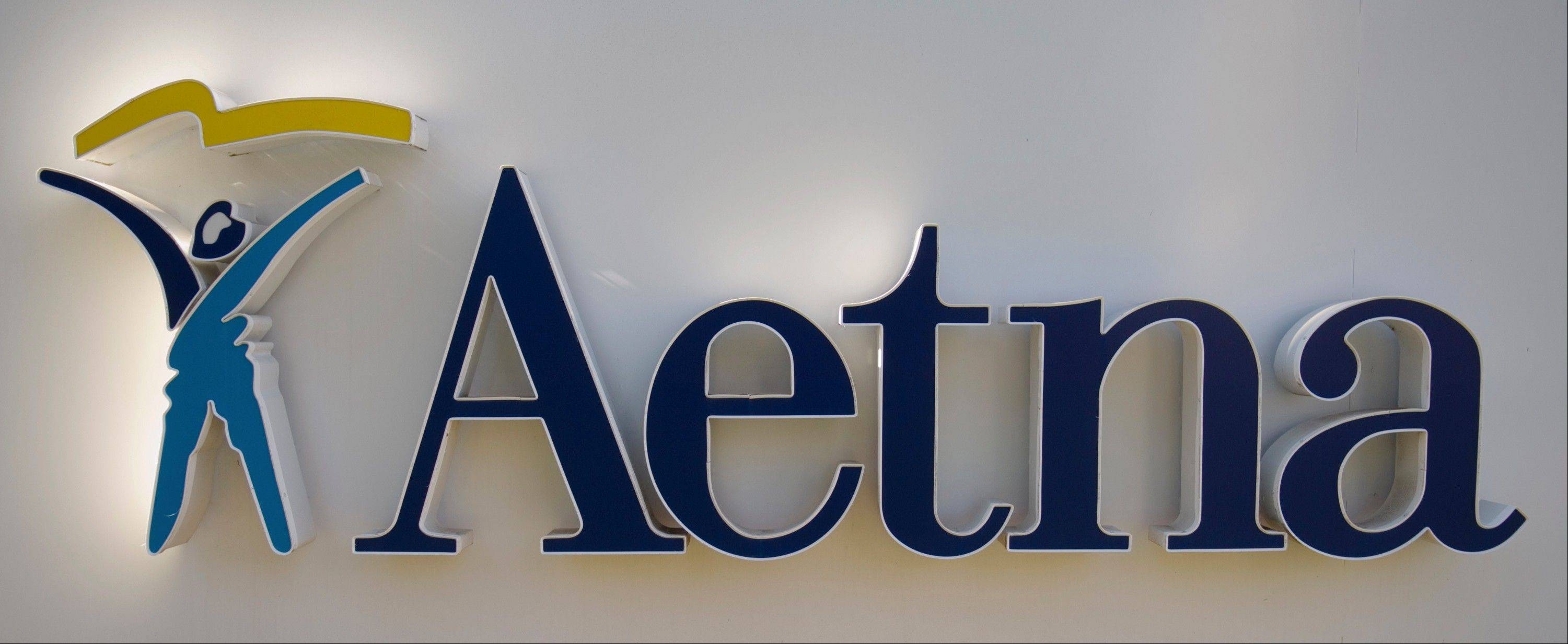 Aetna Inc.�s second-quarter net income tumbled almost 15 percent compared to last year when slower-than-expected growth in health care use helped earnings.