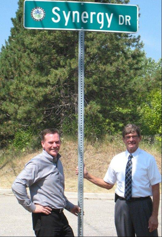 Synergy CEO Rod Sowders, left, poses with Wauconda Mayor Mark Knigge by a street that was renamed by the village to welcome the new Synergy Flavors Inc. The company is moving into a 145,000-square-foot facility later this week.