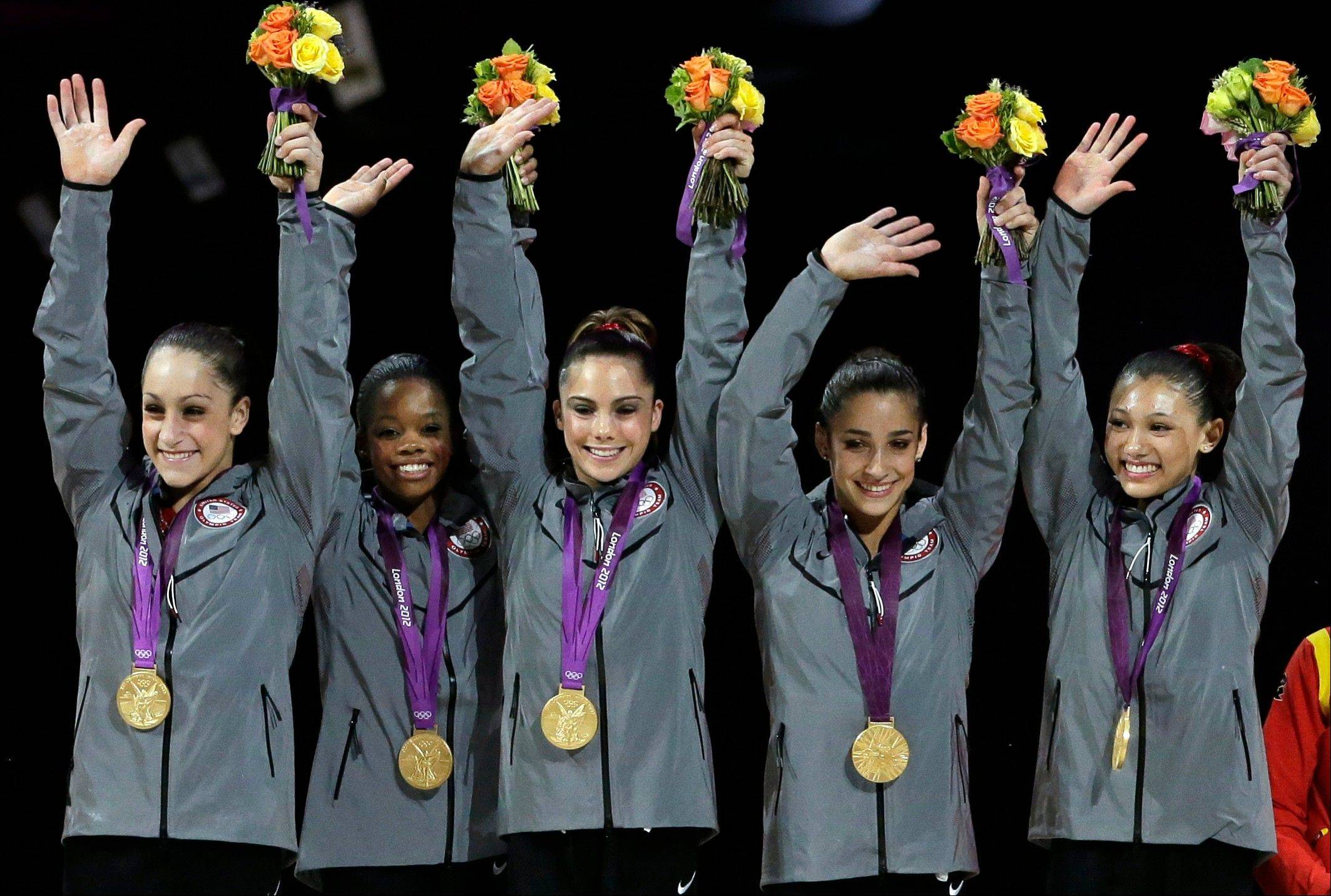 U.S. gymnasts, left to right, Jordyn Wieber, Gabrielle Douglas, McKayla Maroney, Alexandra Raisman, Kyla Ross raise their hands on the podium during the medal ceremony during the Artistic Gymnastic women�s team final at the 2012 Summer Olympics, Tuesday, July 31, 2012, in London. Team U.S. won the gold.