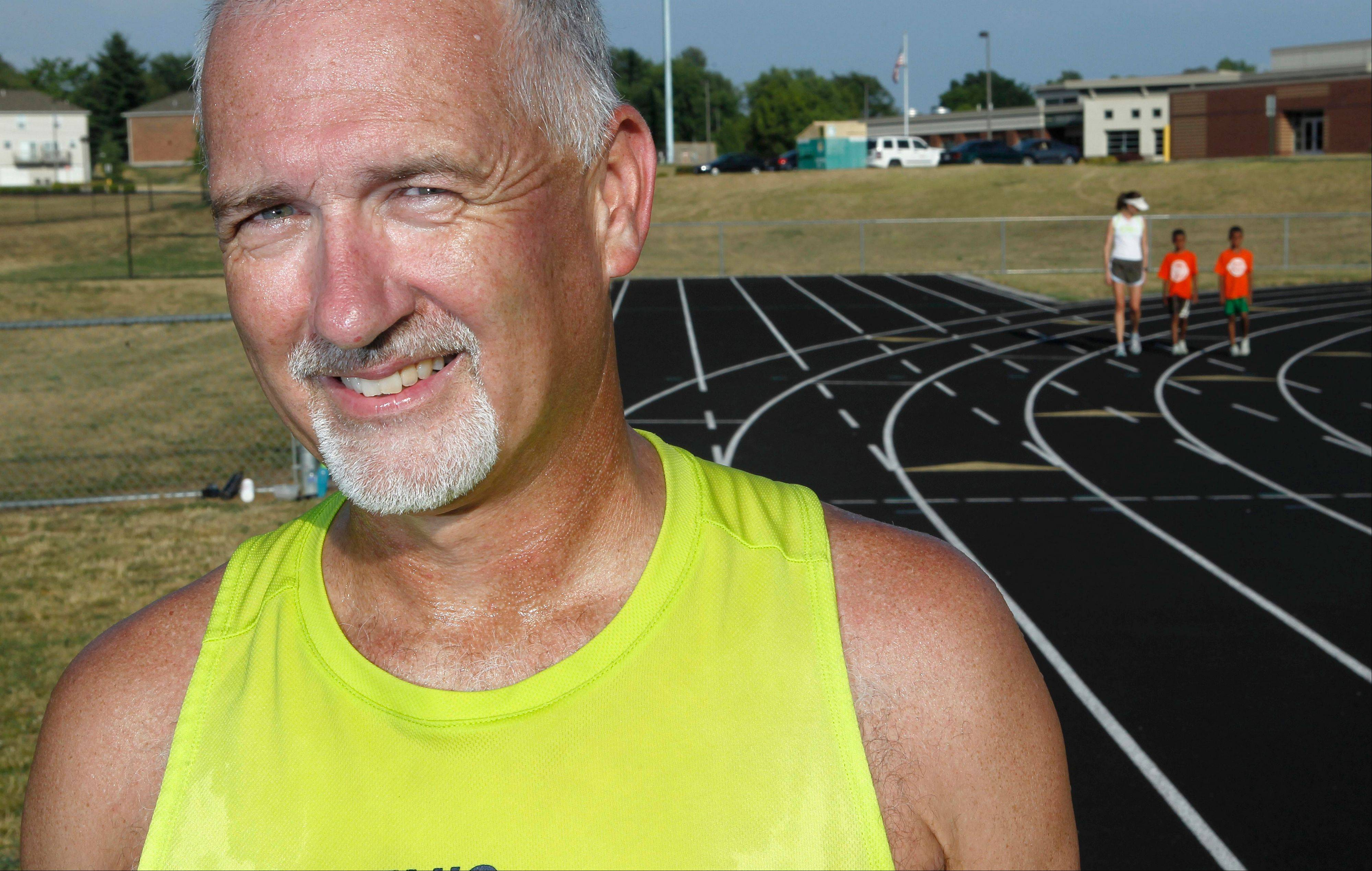 Art Sheridan, 52, of Swansea, is seen at the track at Shiloh Middle School in Shiloh, Ill.