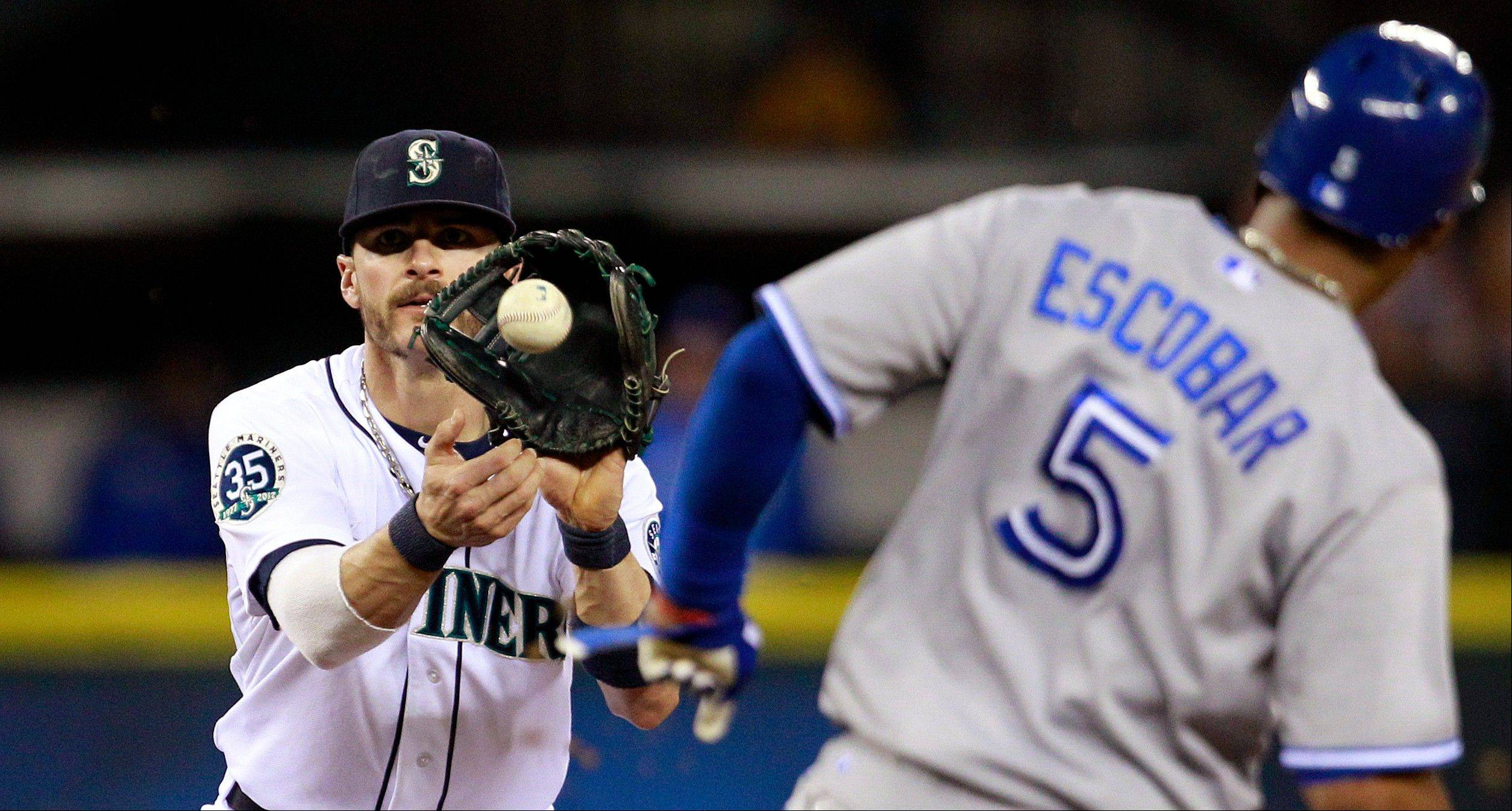 Mariners shortstop Brendan Ryan forces out Toronto�s Yunel Escobar at second base in the fifth inning Tuesday in Seattle.